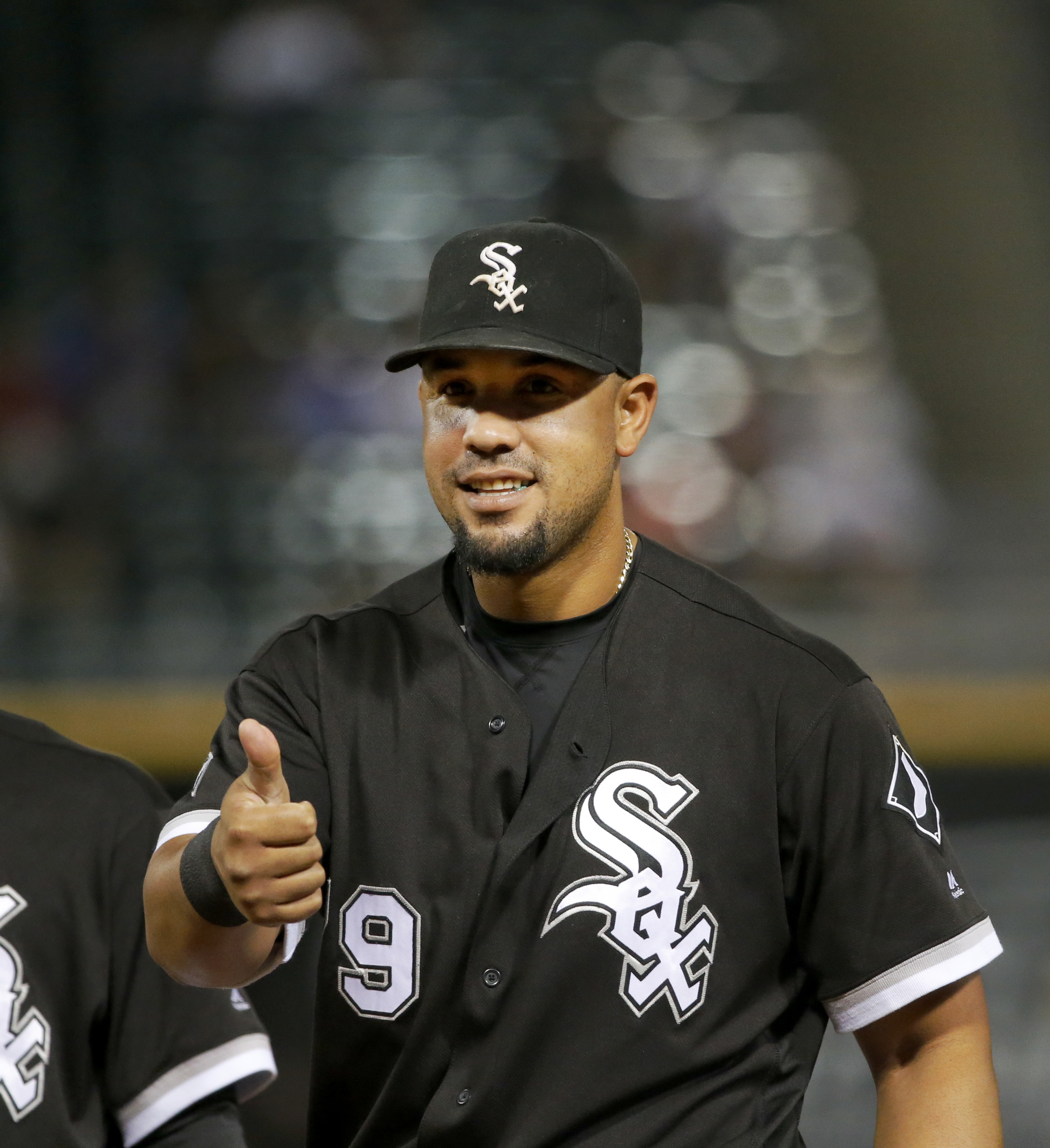 Chicago White Sox's Jose Abreu gives Cleveland Indians' Jason Kipnis the thumbs up after their minor collision at first during the third inning of a baseball game Monday, Sept. 12, 2016, in Chicago. Kipnis was out on the play. (AP Photo/Charles Rex Arboga