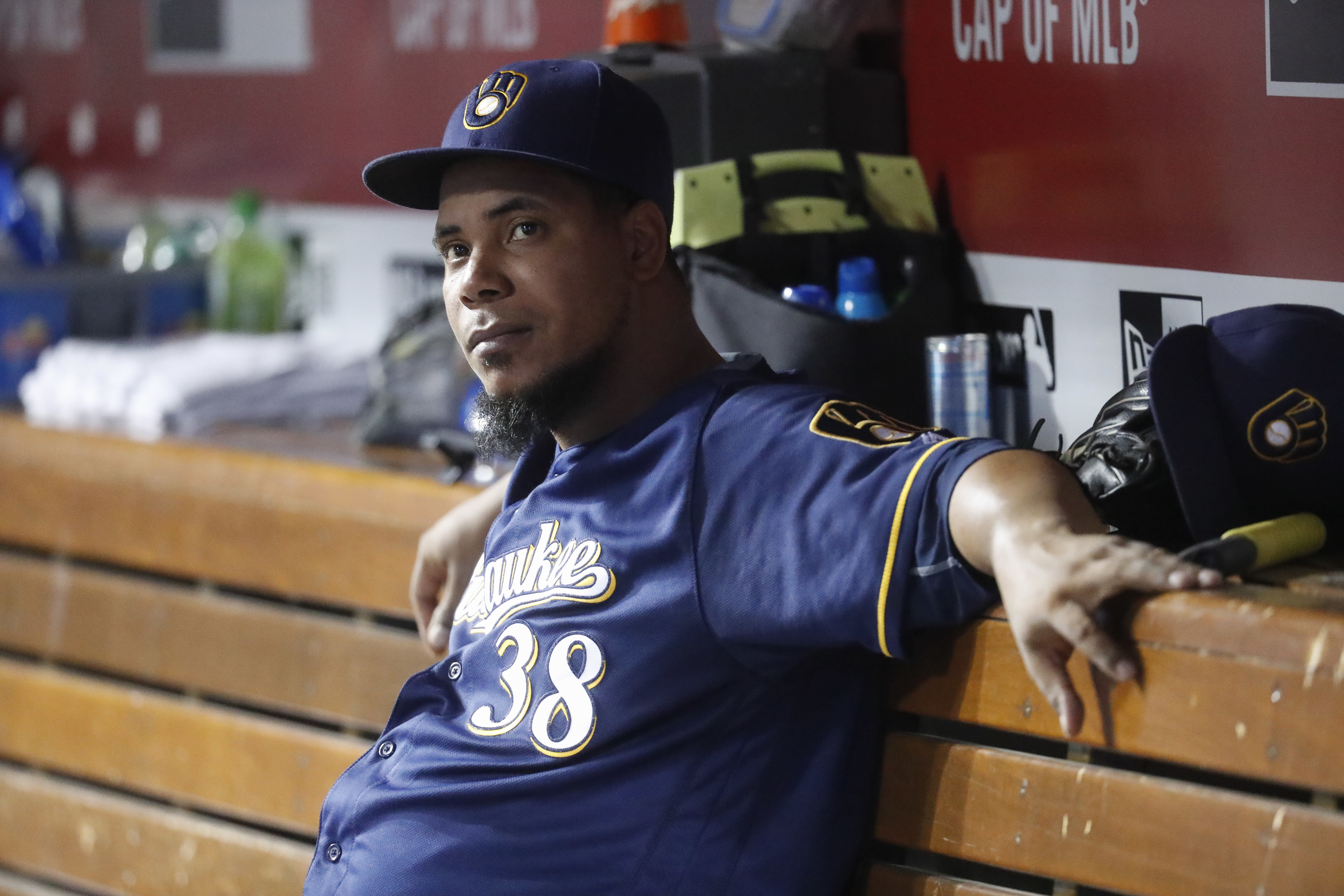 Milwaukee Brewers starting pitcher Wily Peralta sits in the dugout in the seventh inning of a baseball game against the Cincinnati Reds, Monday, Sept. 12, 2016, in Cincinnati. (AP Photo/John Minchillo)
