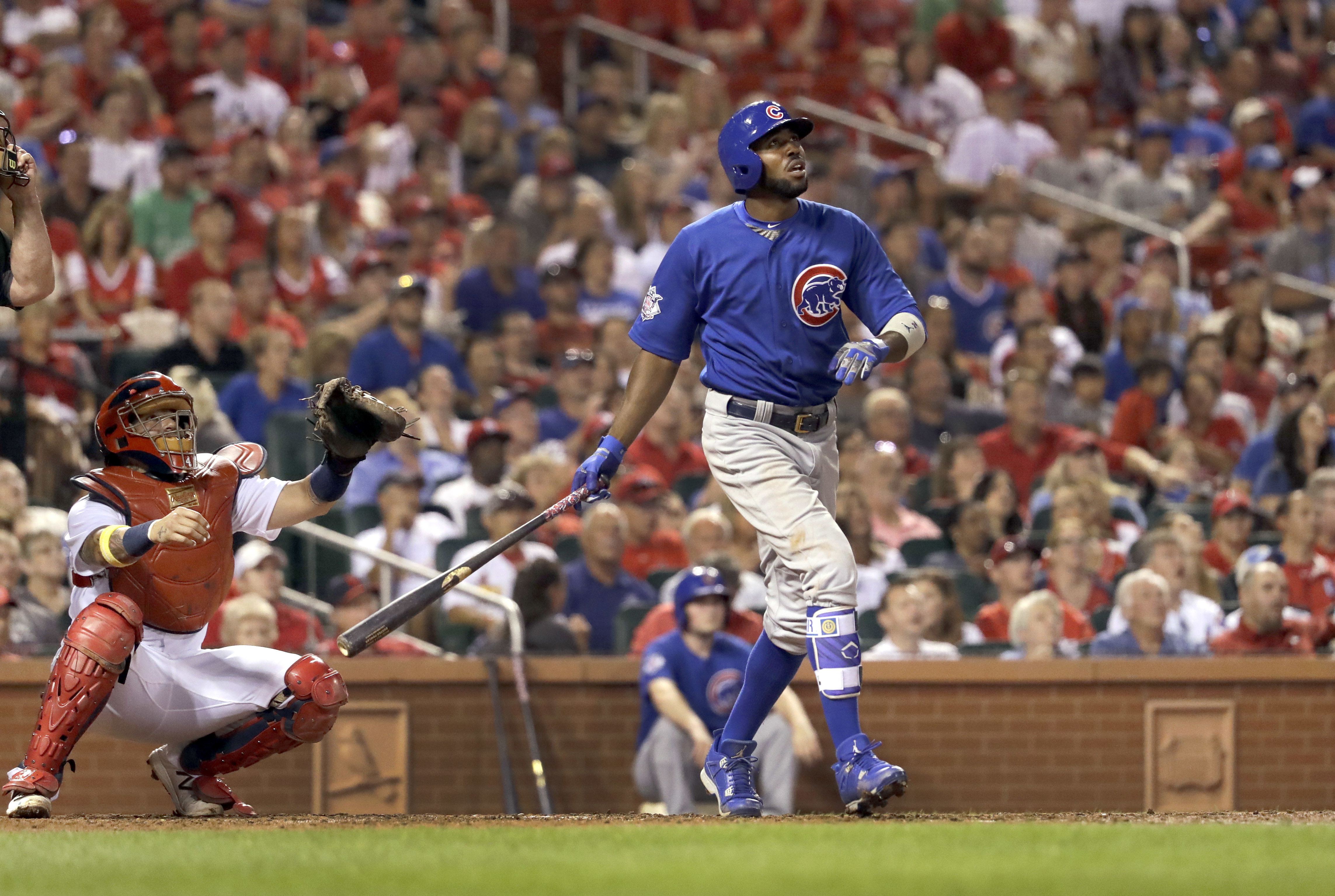 Chicago Cubs' Dexter Fowler, right, and St. Louis Cardinals catcher Yadier Molina watch Fowler's two-run home run during the fifth inning of a baseball game Monday, Sept. 12, 2016, in St. Louis. (AP Photo/Jeff Roberson)
