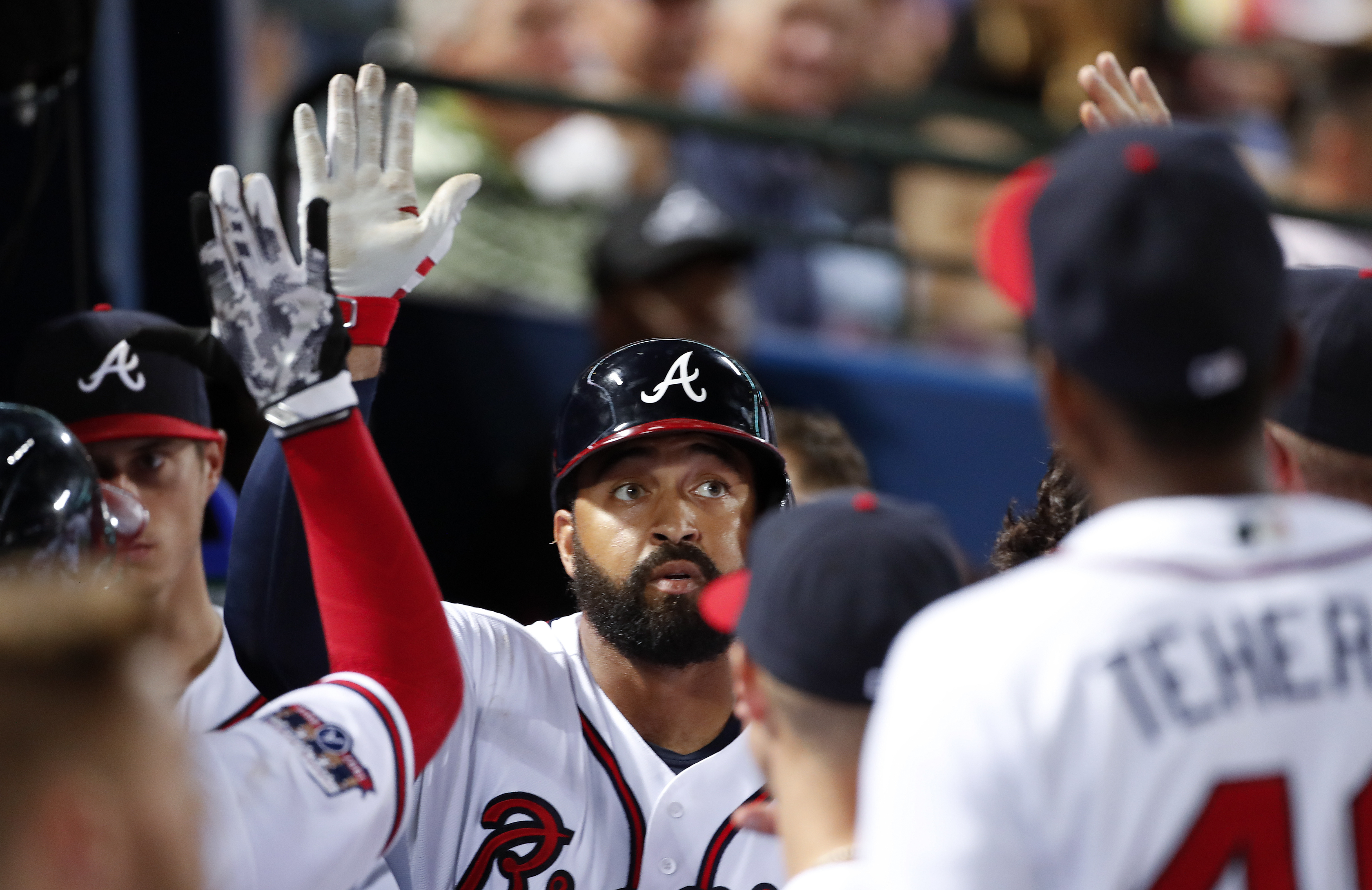 Atlanta Braves' Matt Kemp celebrates with his teammates after hitting a solo-home run in the fourth inning of baseball game against the Miami Marlins, Tuesday, Sept. 13, 2016, in Atlanta. (AP Photo/John Bazemore)
