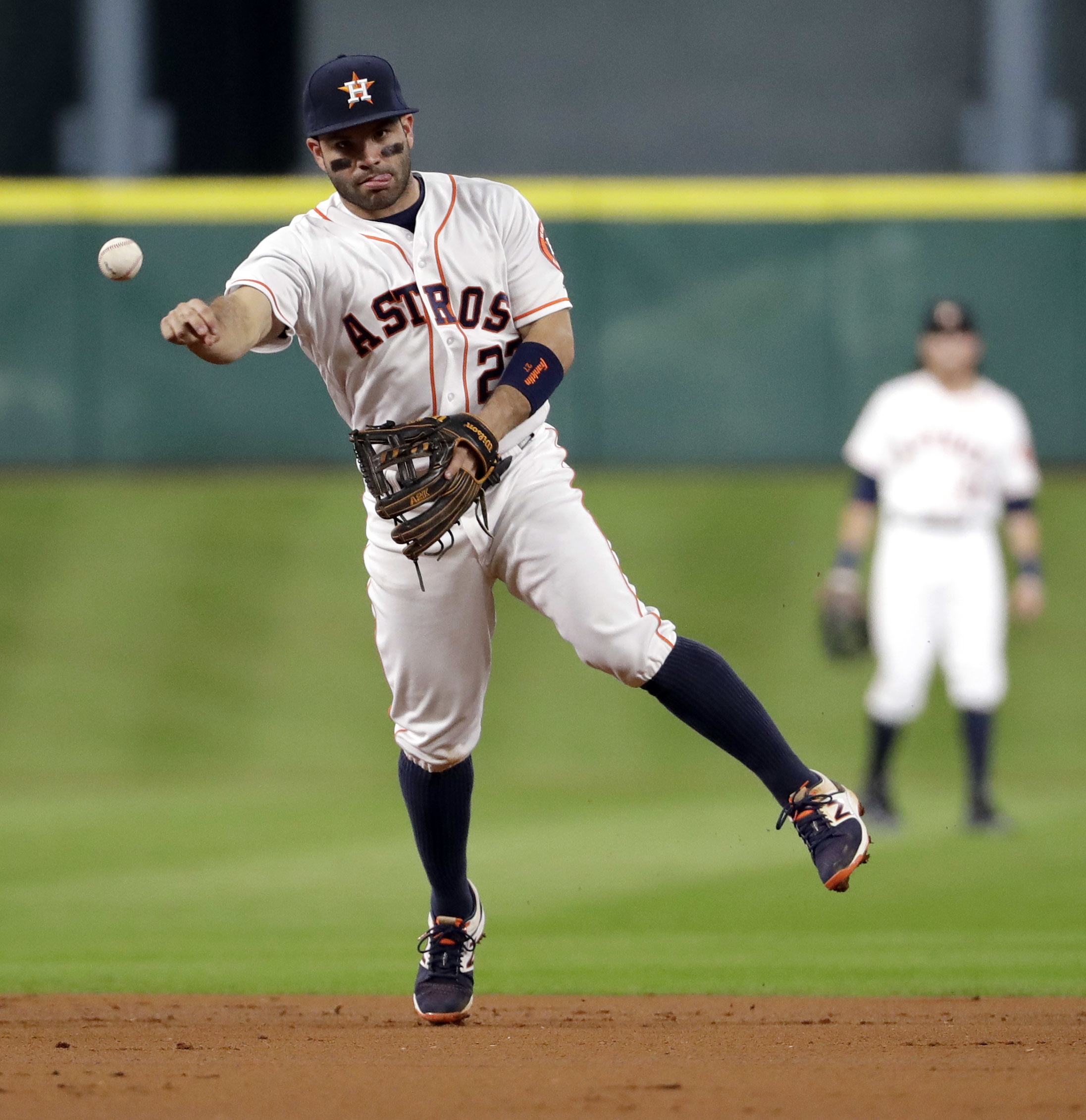 Houston Astros second baseman Jose Altuve throws to first for the out after fielding a grounder by Texas Rangers' Robinson Chirinos during the third inning of a baseball game Tuesday, Sept. 13, 2016, in Houston. (AP Photo/David J. Phillip)