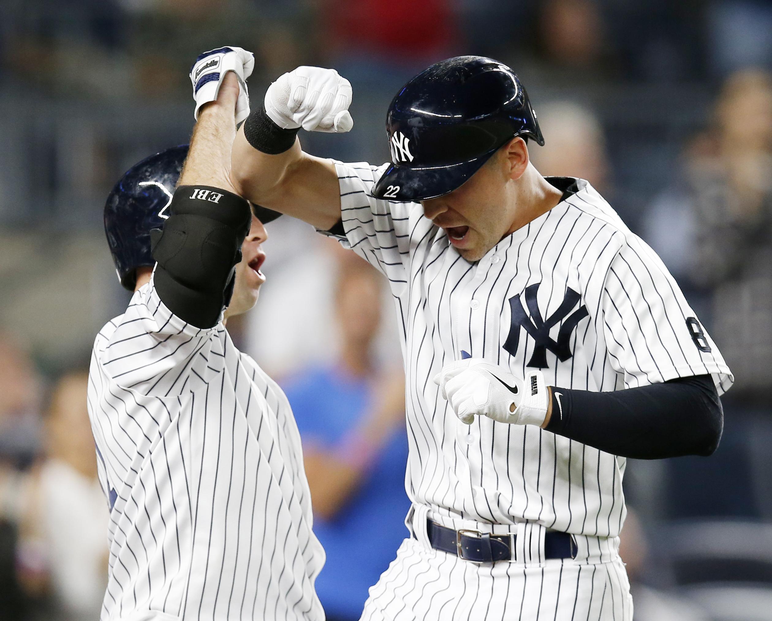 New York Yankees' Brett Gardner, left, celebrates with pinch-hitter Jacoby Ellsbury after Ellsbury' seventh-inning solo home run in New York, Tuesday, Sept. 13, 2016. (AP Photo/Kathy Willens)