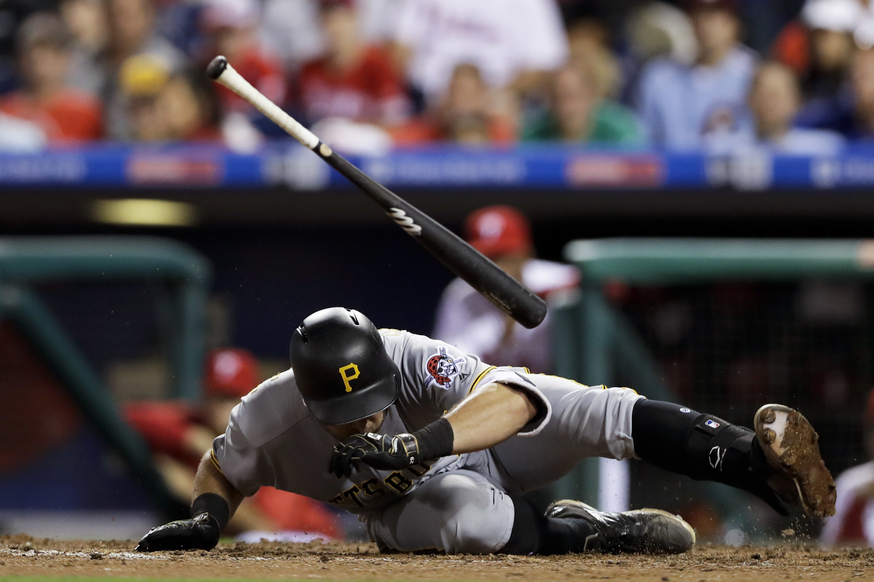 Pittsburgh Pirates' Francisco Cervelli dives to avoid a pitch from Philadelphia Phillies' Michael Mariot during the seventh inning of a baseball game, Tuesday, Sept. 13, 2016, in Philadelphia. Pittsburgh won 5-3. (AP Photo/Matt Slocum)