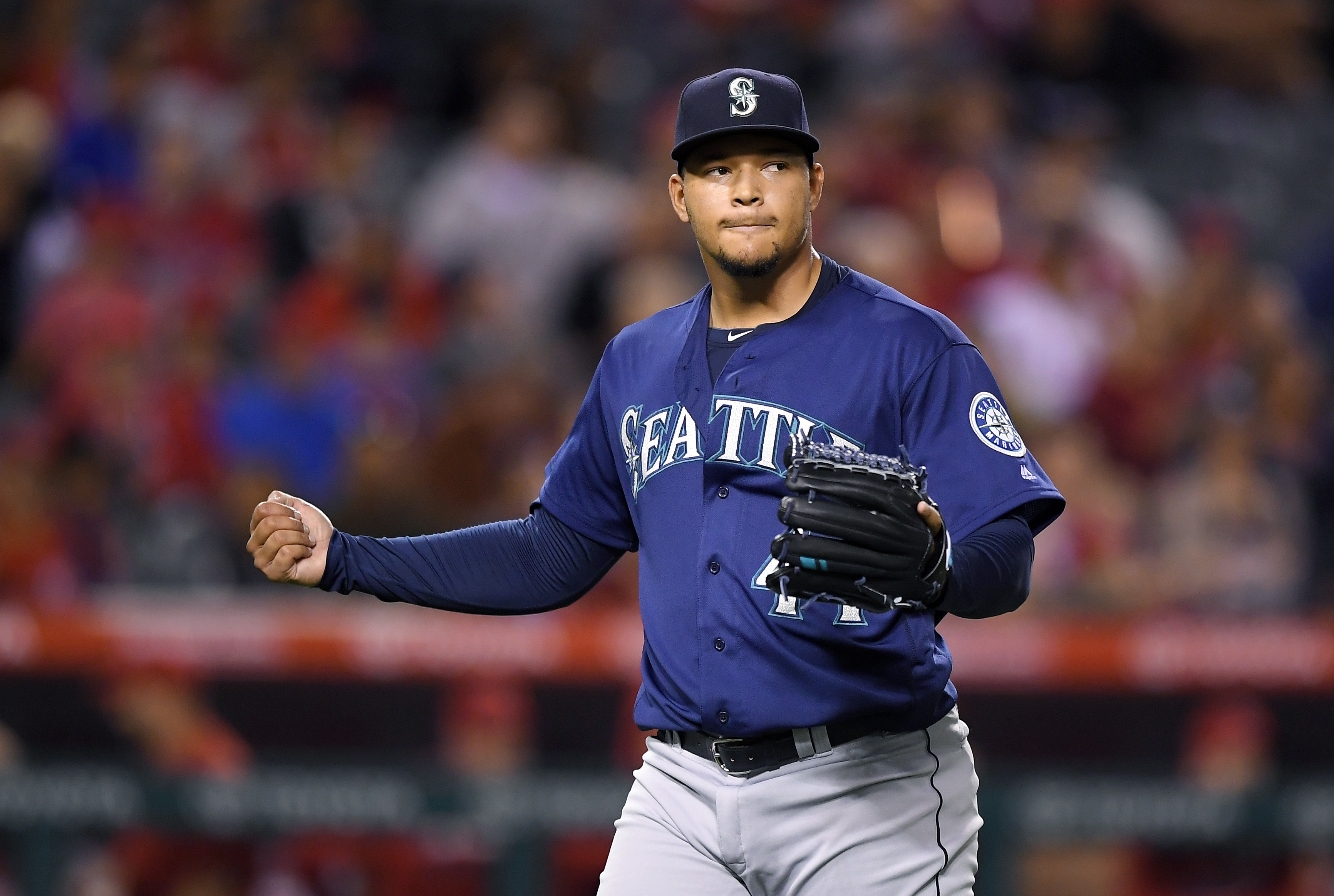 Seattle Mariners starting pitcher Taijuan Walker claps after finishing the fifth inning of a baseball game against the Los Angeles Angels, Tuesday, Sept. 13, 2016, in Anaheim, Calif. (AP Photo/Mark J. Terrill)