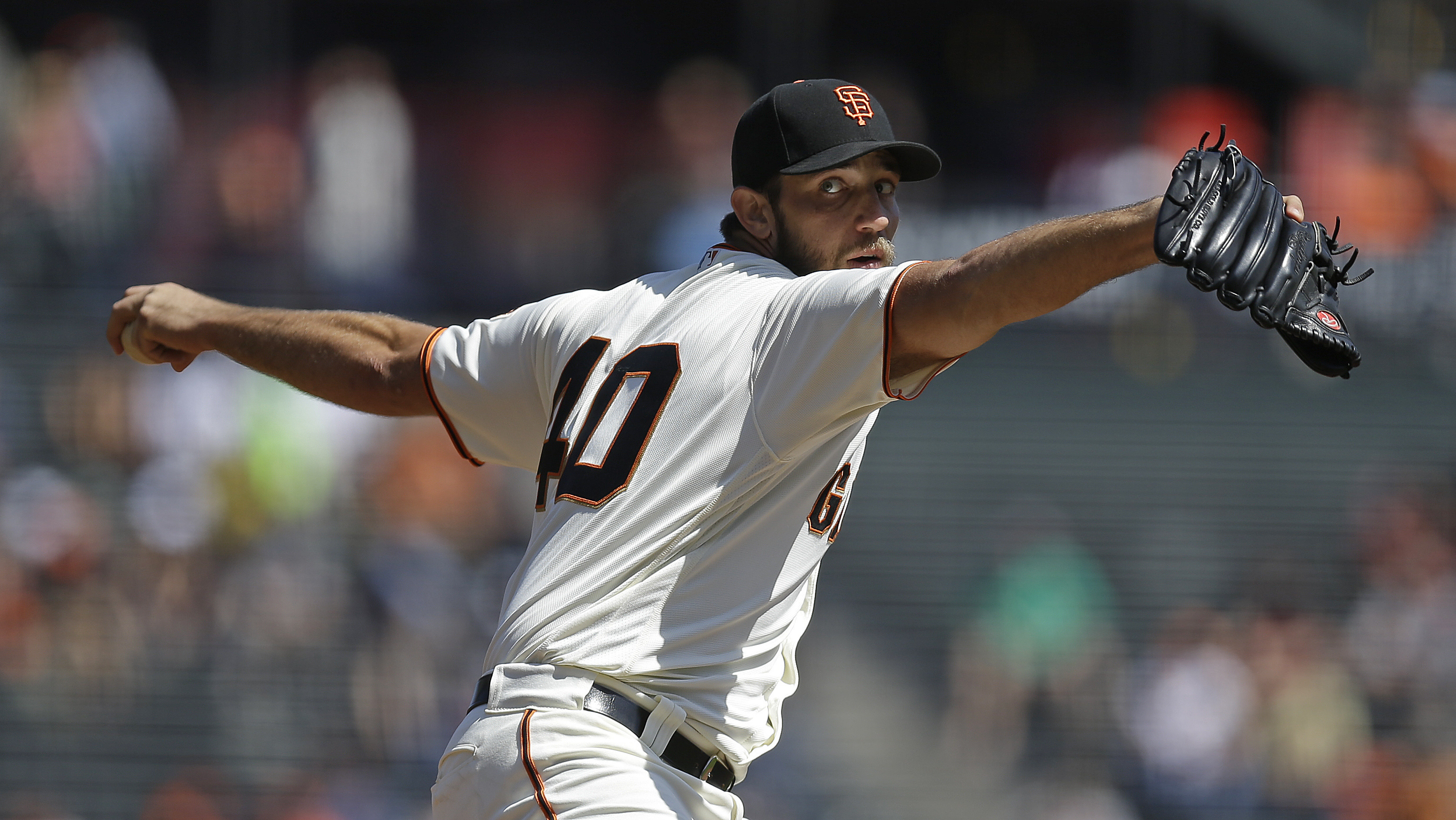 San Francisco Giants pitcher Madison Bumgarner works against the San Diego Padres in the first inning of a baseball game Wednesday, Sept. 14, 2016, in San Francisco. (AP Photo/Ben Margot)