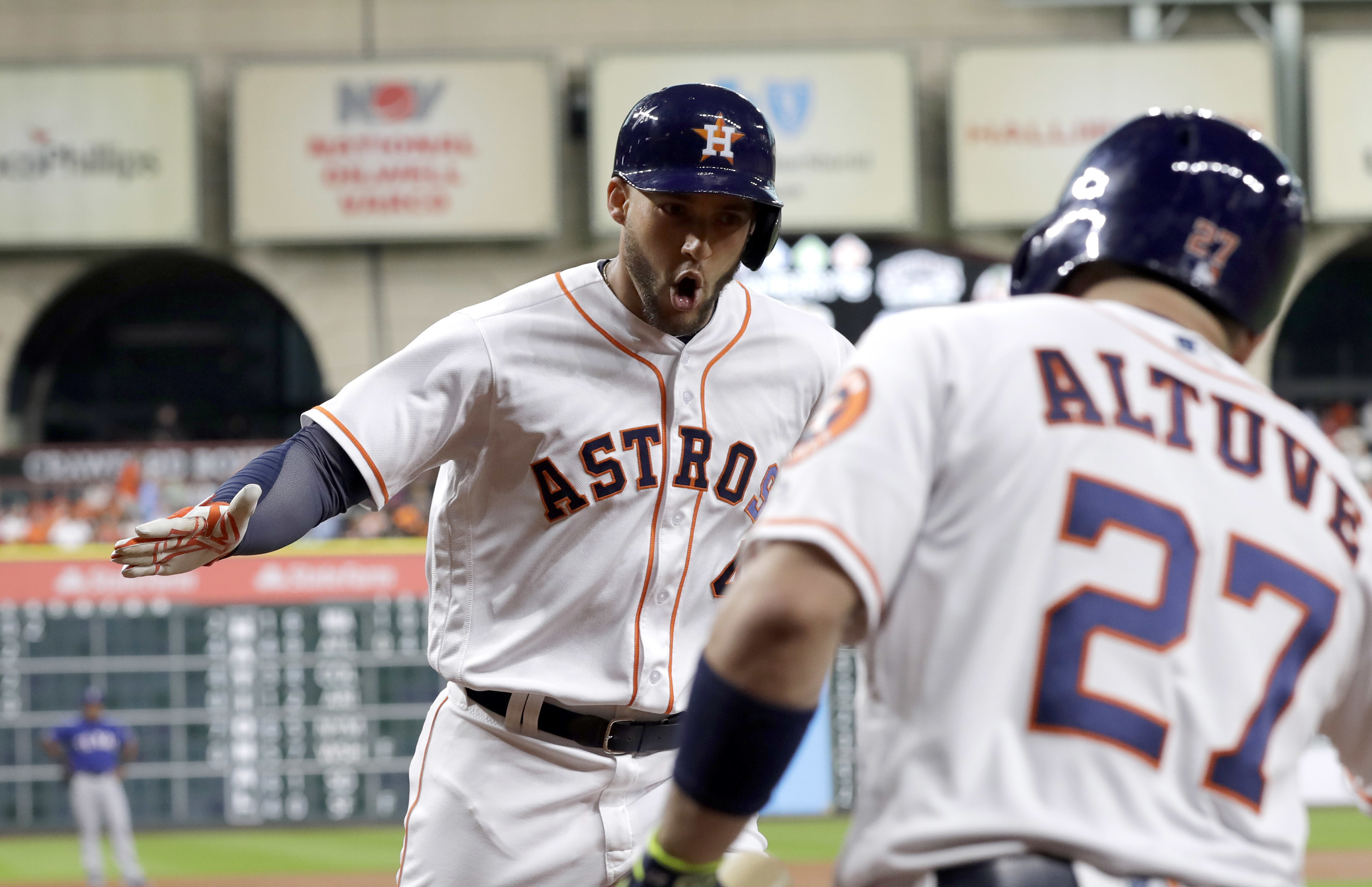 Houston Astros' George Springer, left, celebrates with Jose Altuve (27) after hitting a home run against the Texas Rangers during the first inning of a baseball game Wednesday, Sept. 14, 2016, in Houston. (AP Photo/David J. Phillip)