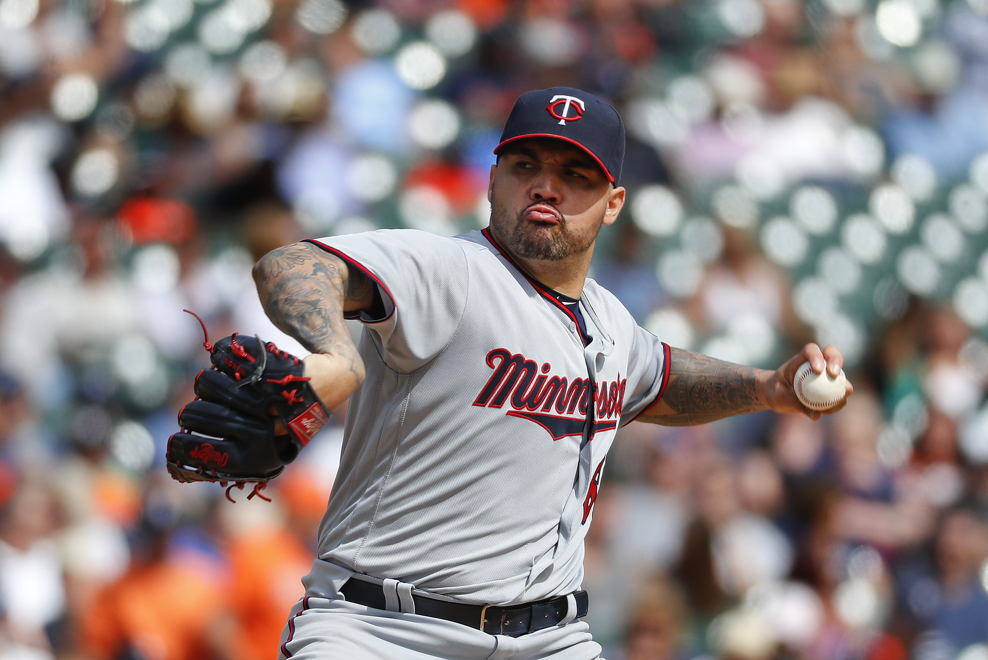Minnesota Twins pitcher Hector Santiago throws against the Detroit Tigers in the fifth inning of a baseball game in Detroit, Thursday, Sept. 15, 2016. (AP Photo/Paul Sancya)