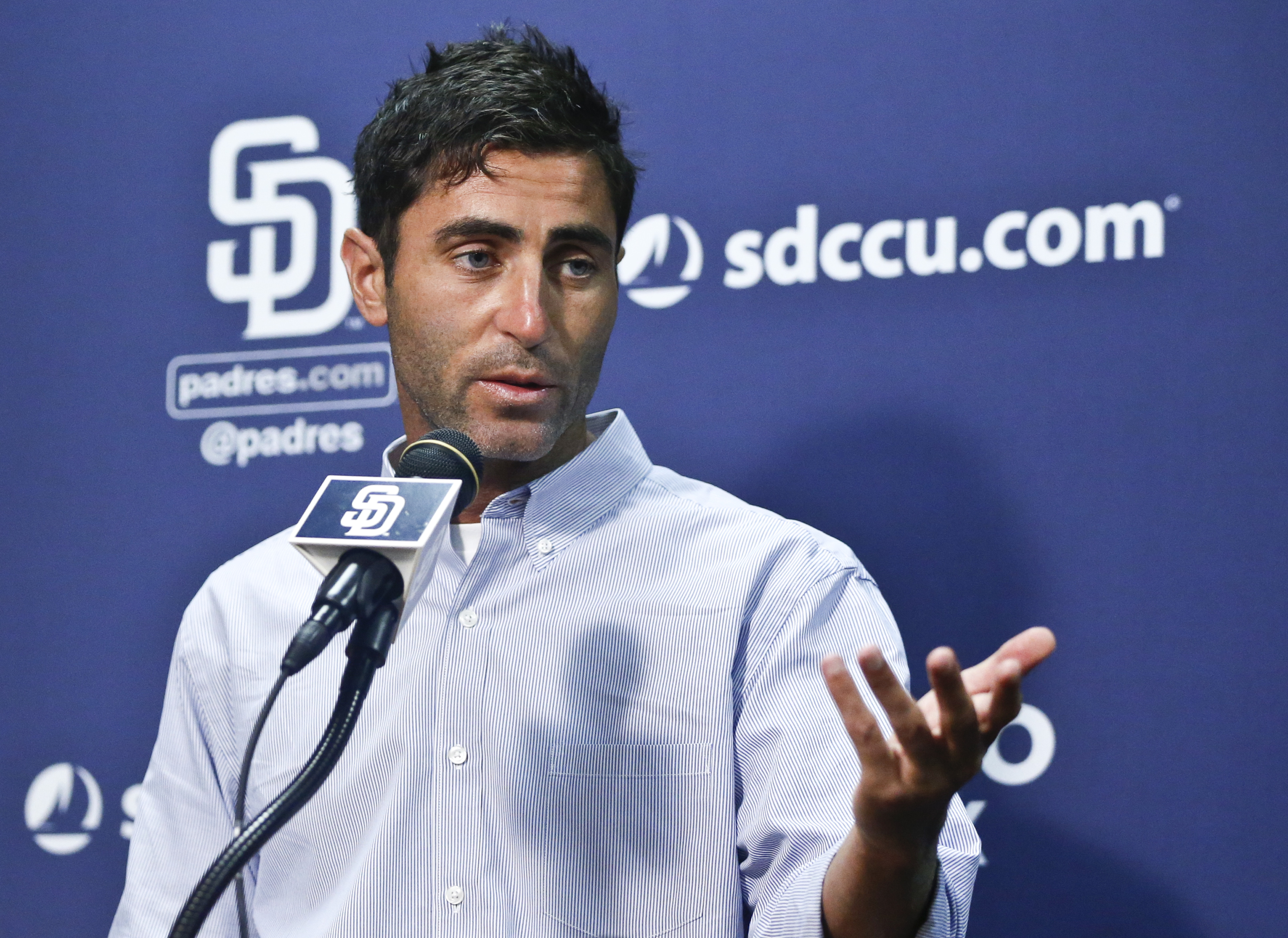 San Diego Padres general manager A.J. Preller answers questions about the trading of all-star pitcher Drew Pomeranz to the Boston Red Sox prior to a baseball game against the San Francisco Giants Friday, July 15, 2016, in San Diego. (AP Photo/Lenny Ignelz