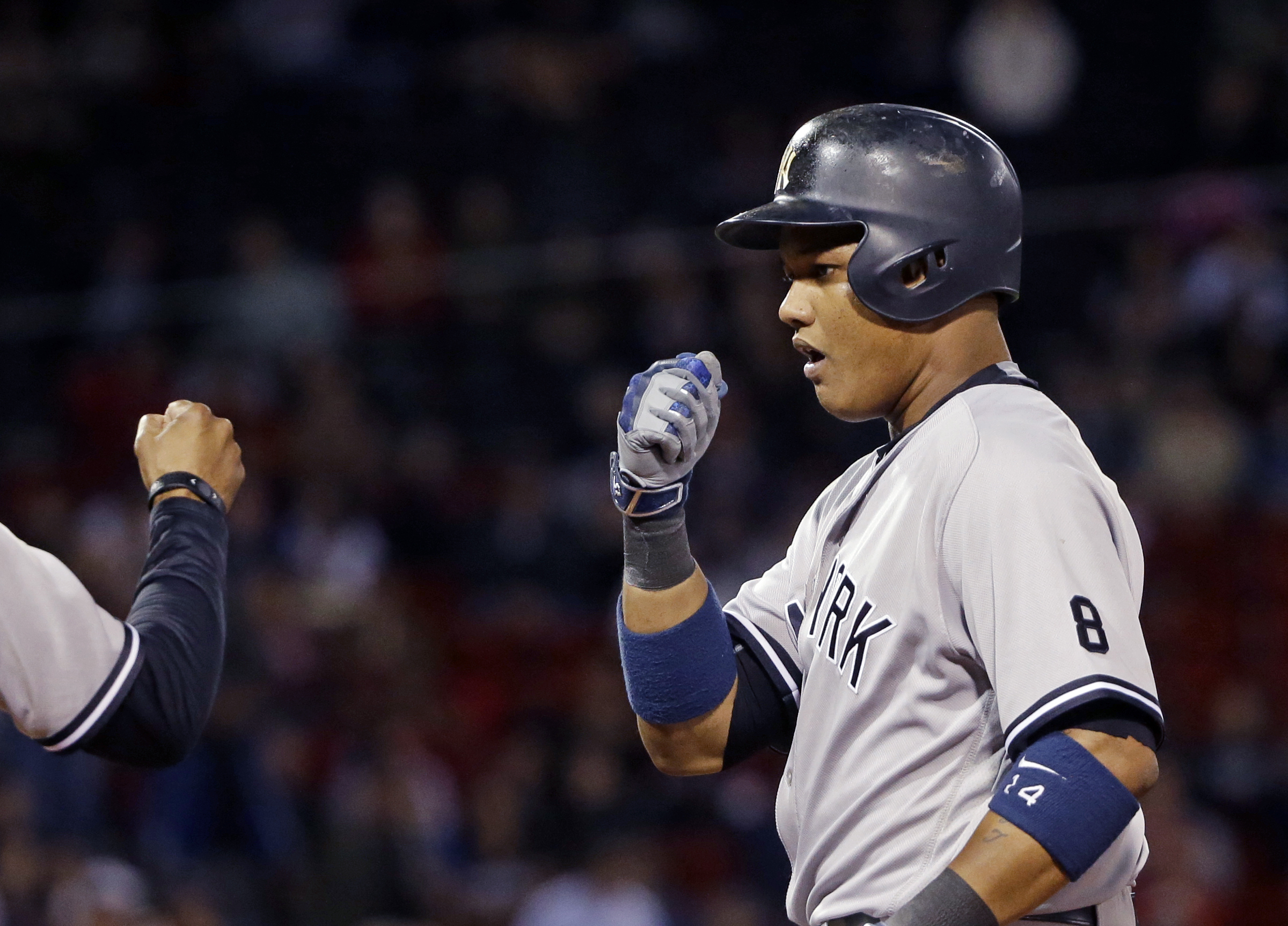 New York Yankees' Starlin Castro celebrates after hitting a single during the ninth inning of a baseball game against the Boston Red Sox at Fenway Park, Thursday, Sept. 15, 2016, in Boston. (AP Photo/Elise Amendola)