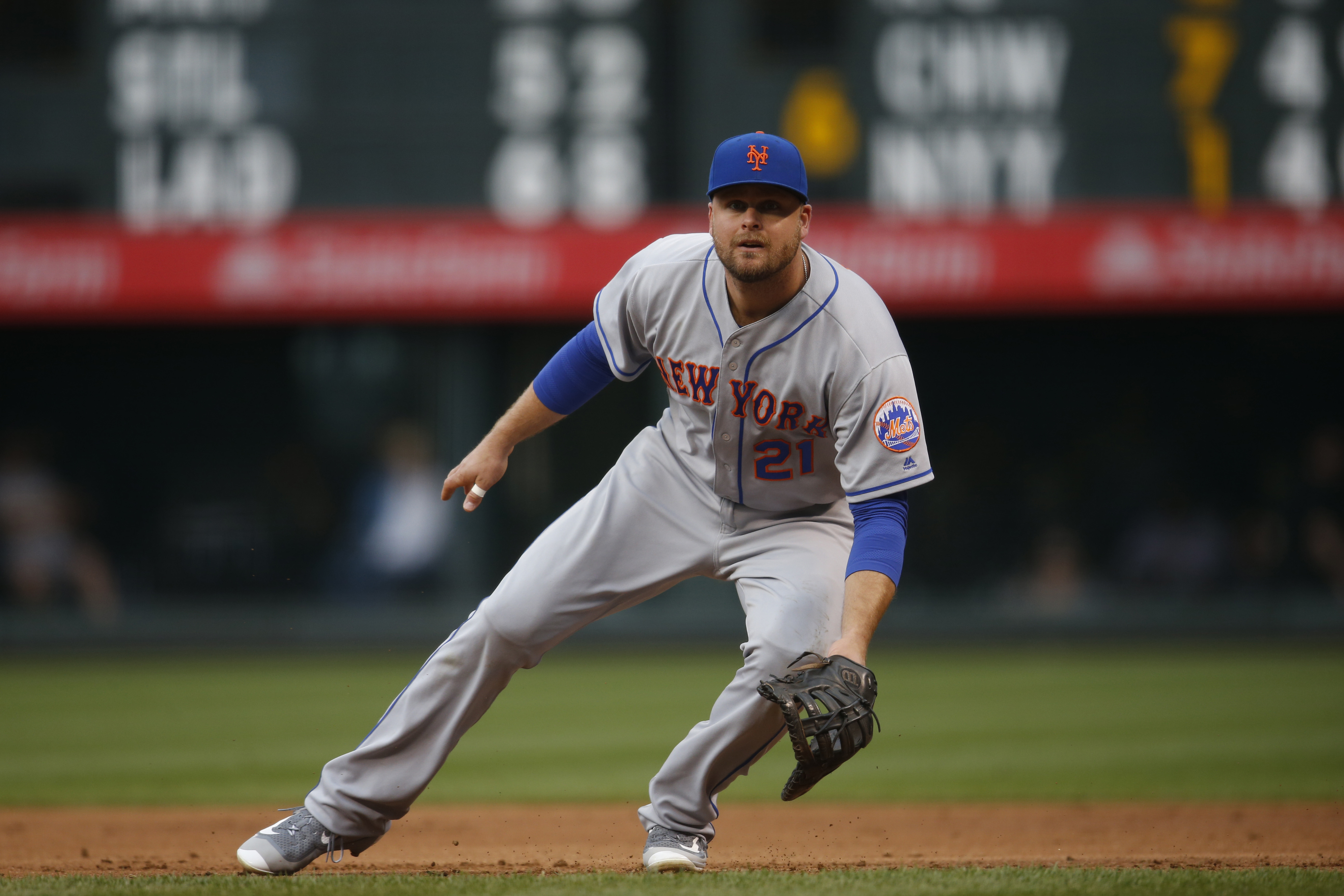 FILE - In this May 13, 2016, file photo, New York Mets first baseman Lucas Duda (21) prepares to field a ball in the first inning of a baseball game against the Colorado Rockies in Denver. Duda will come off the disabled list this weekend after recovering
