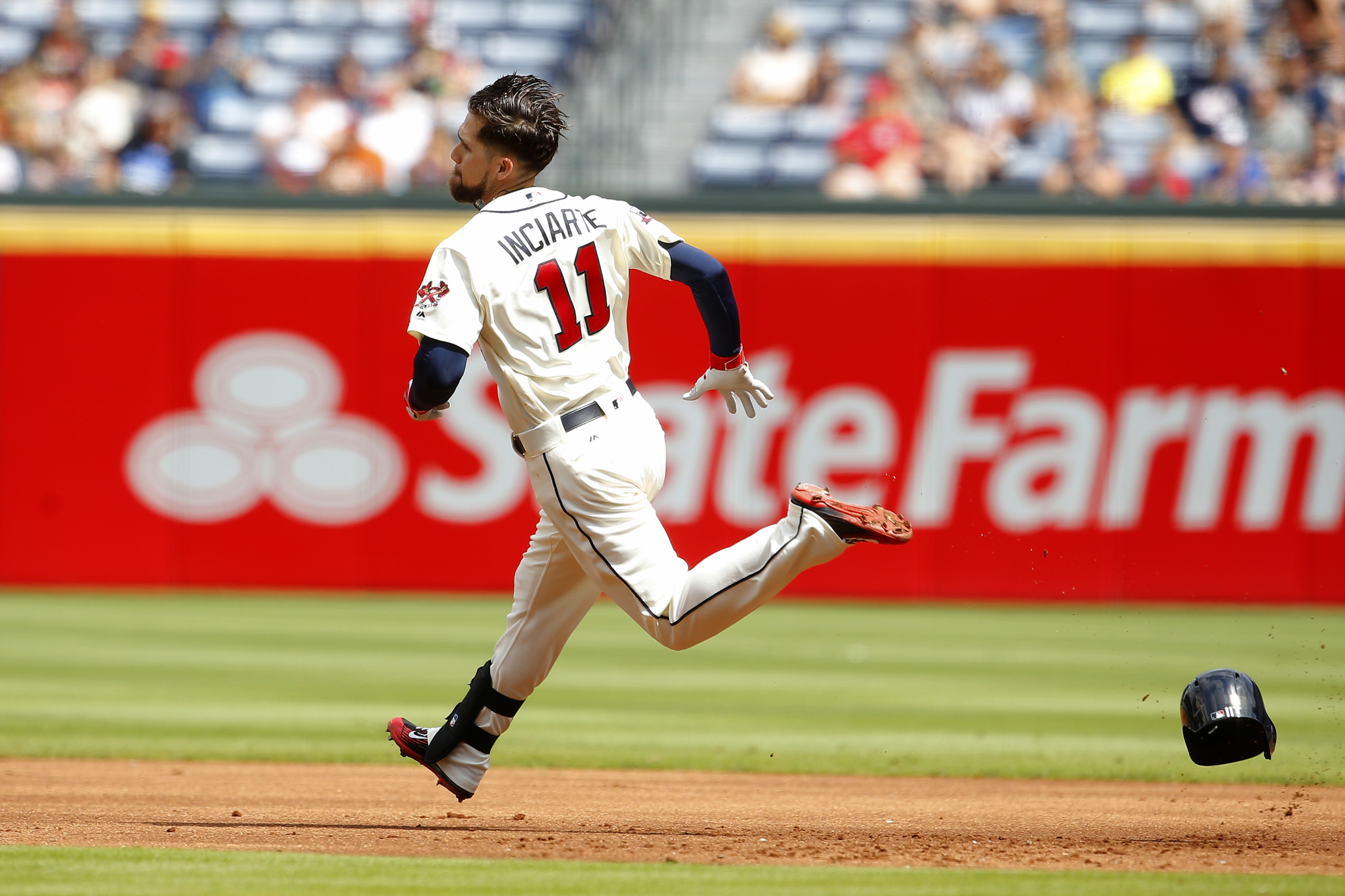 Atlanta Braves Ender Inciarte (11) rounds first after hitting a double in the first inning of a baseball game against the Washington Nationals, Saturday, Sep. 17, 2016, in Atlanta. (AP Photo/Todd Kirkland)