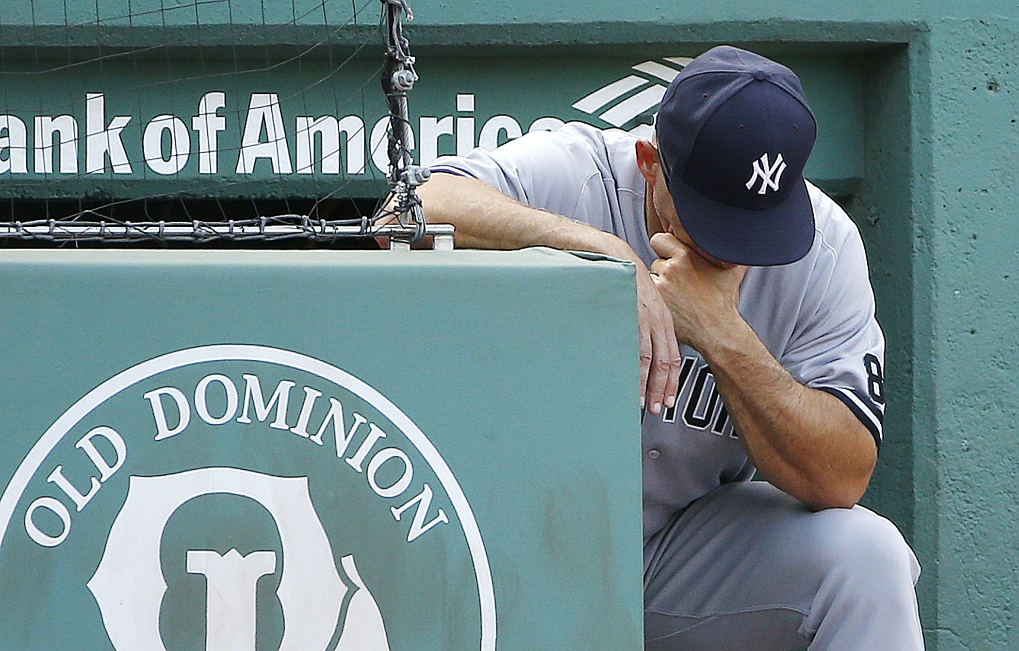 New York Yankees manager Joe Girardi looks down during the eighth inning of a baseball game against the Boston Red Sox in Boston, Saturday, Sept. 17, 2016. The Red Sox won 6-5. (AP Photo/Michael Dwyer)