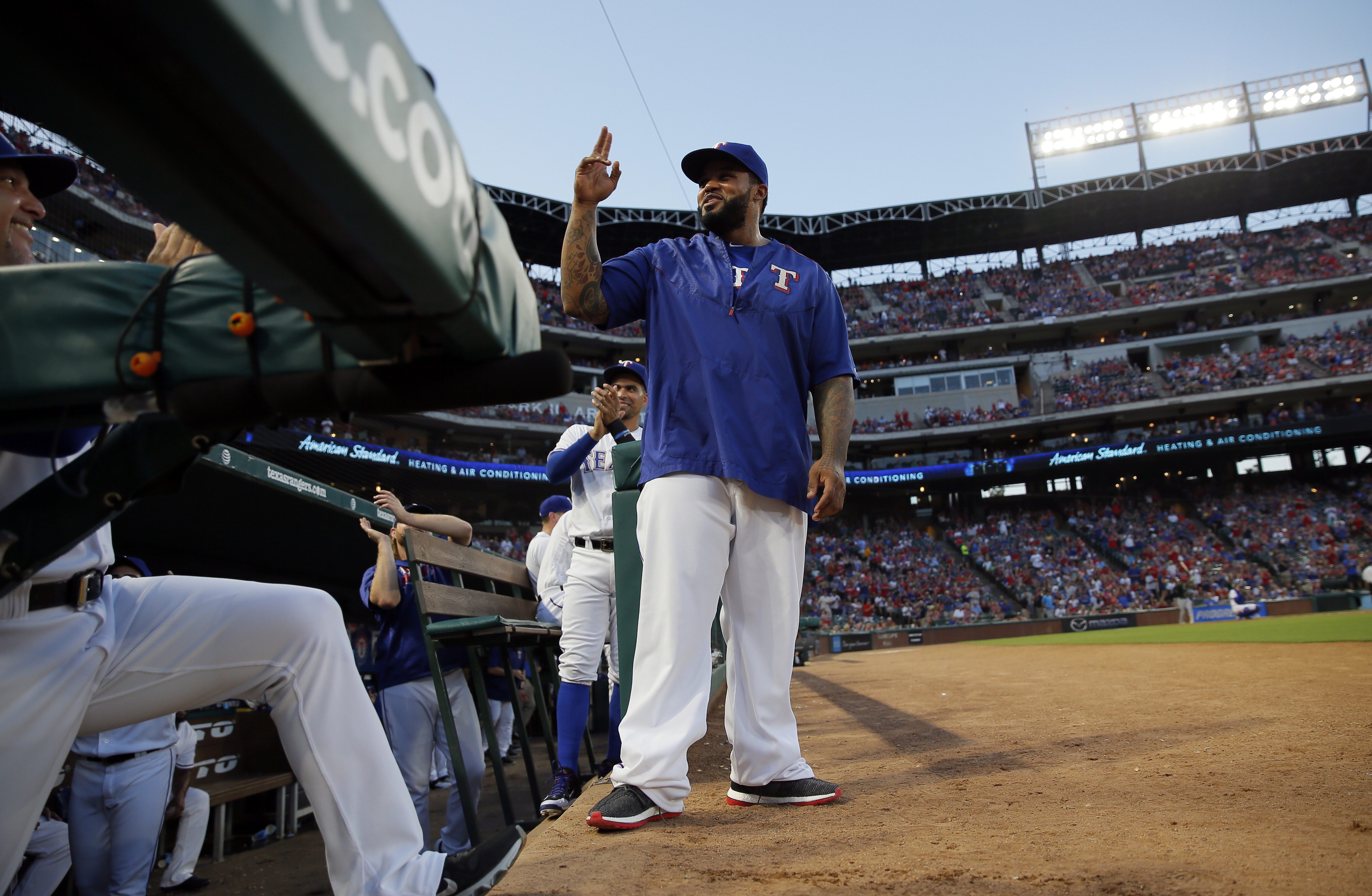 Retired Texas Rangers player Prince Fielder acknowledges fans after being introduced in the first inning of a baseball game against the Oakland Athletics, Saturday, Sept. 17, 2016, in Arlington, Texas. (AP Photo/Tony Gutierrez)