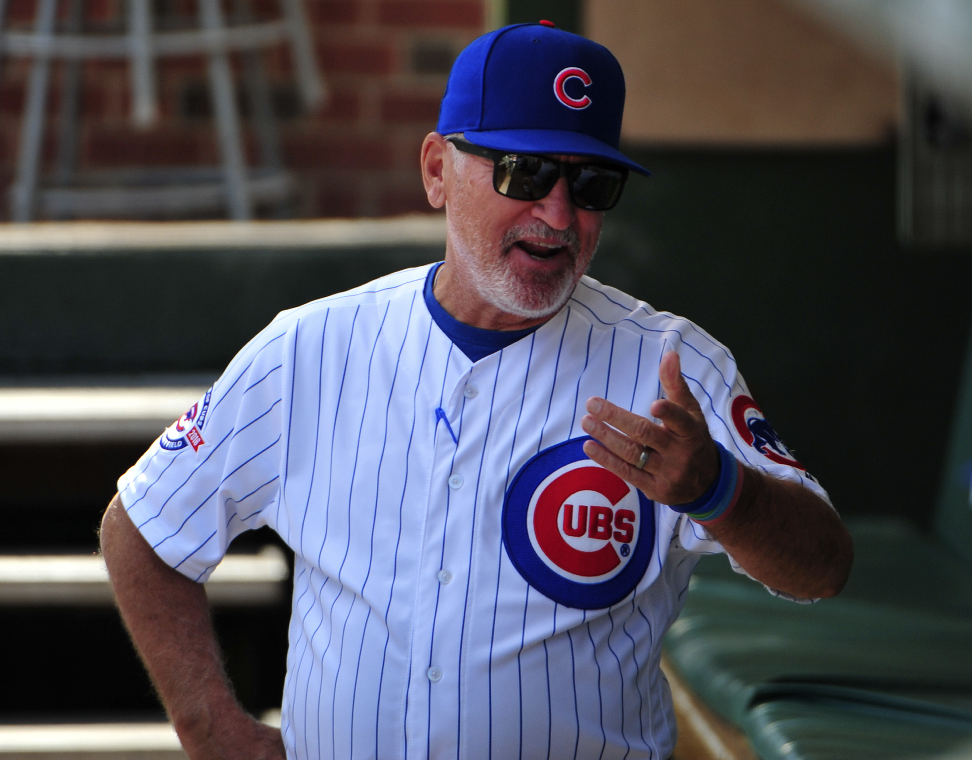 Chicago Cubs manager Joe Maddon talks in the dugout before a baseball game against the Milwaukee Brewers, Sunday, Sept. 18, 2016, in Chicago. (AP Photo/David Banks)