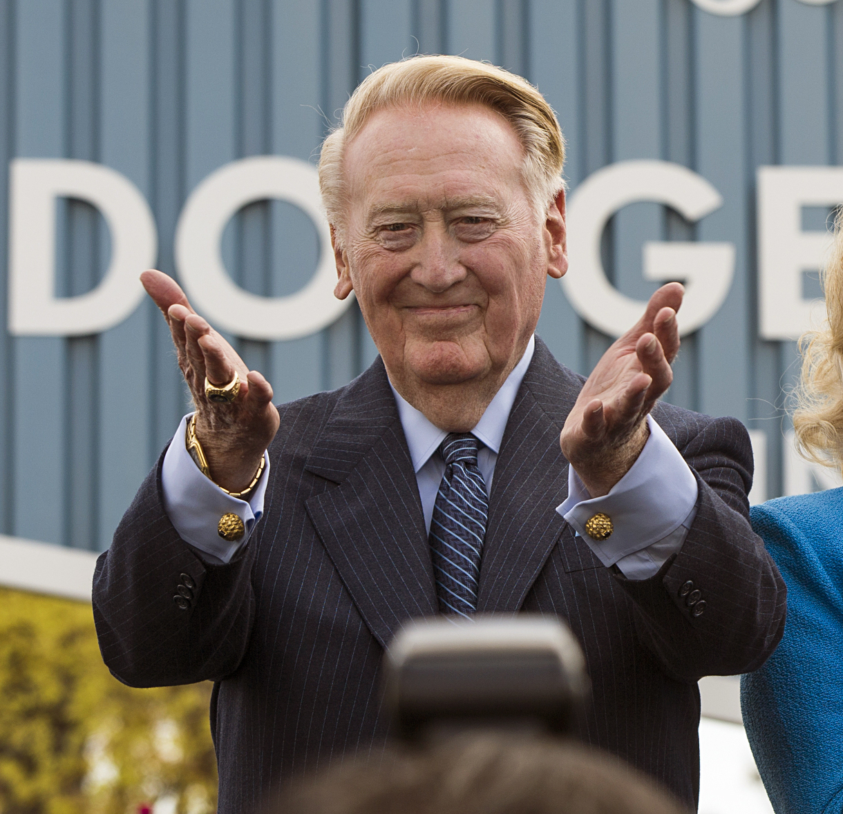 FILE - In this April 11, 2016, file photo, Los Angeles Dodgers legend Vin Scully thanks fans at a dedication ceremony unveiling a street sign of his namesake at the entrance to Dodger Stadium, in Los Angeles. Scully begins his final homestand behind the m