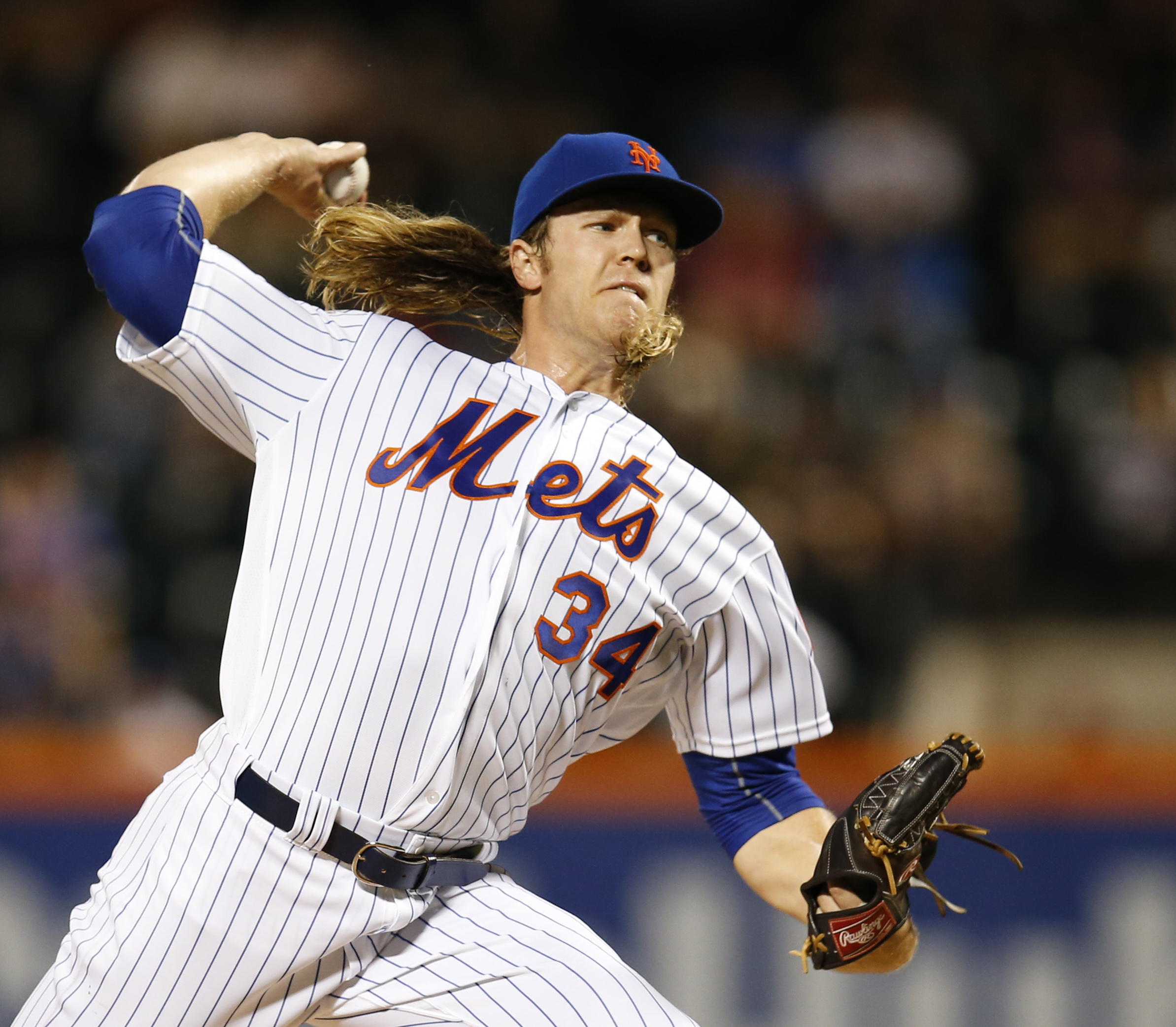 New York Mets' starting pitcher Noah Syndergaard delivers during the first inning of a baseball game against the Atlanta Braves, Monday, Sept. 19, 2016, in New York. (AP Photo/Kathy Willens)