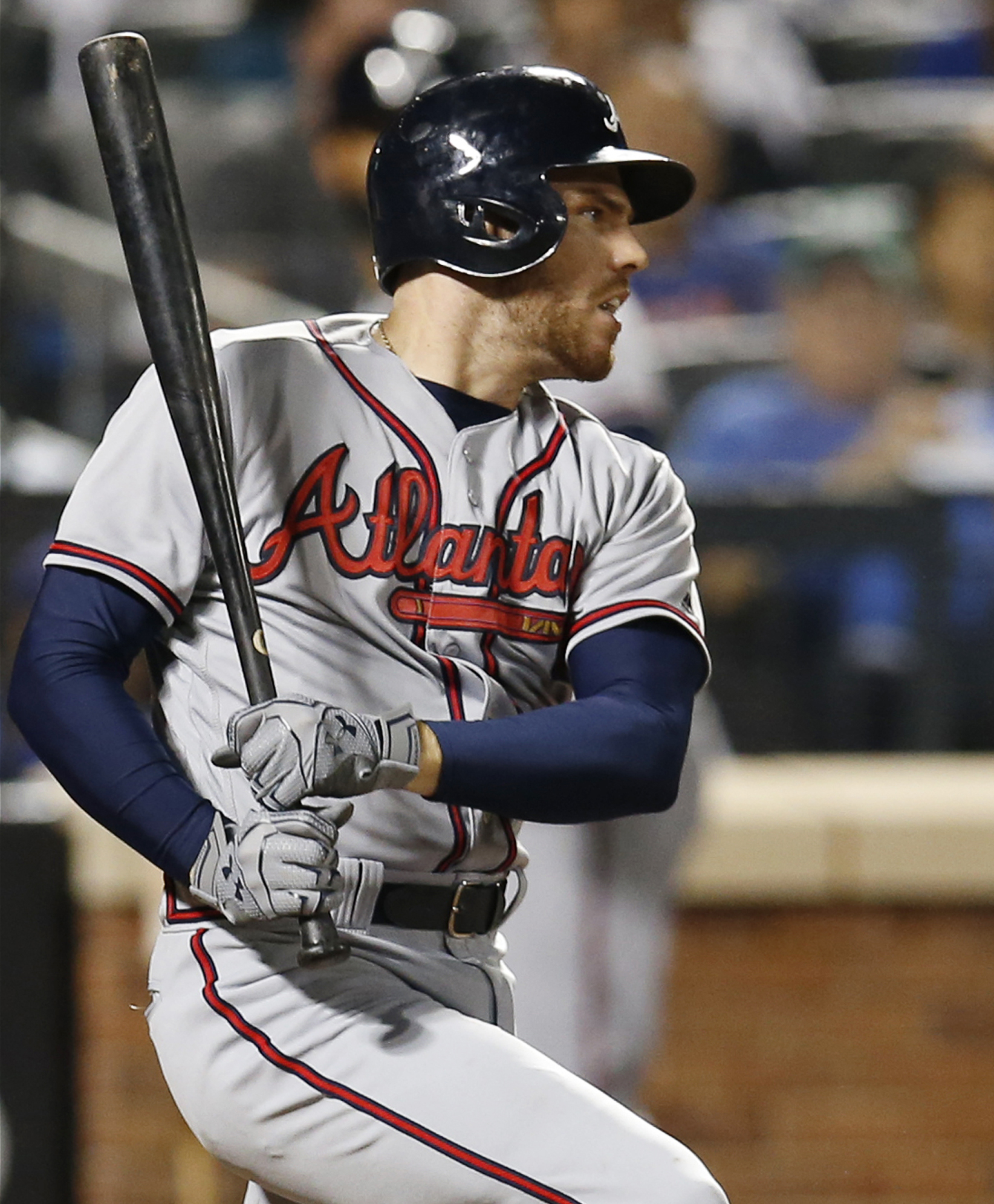 Atlanta Braves' Freddie Freeman hits a seventh-inning infield single in a baseball game against the New York Mets, Monday, Sept. 19, 2016, in New York. Freeman had a fourth-inning, two-run double and a first inning solo home run. (AP Photo/Kathy Willens)