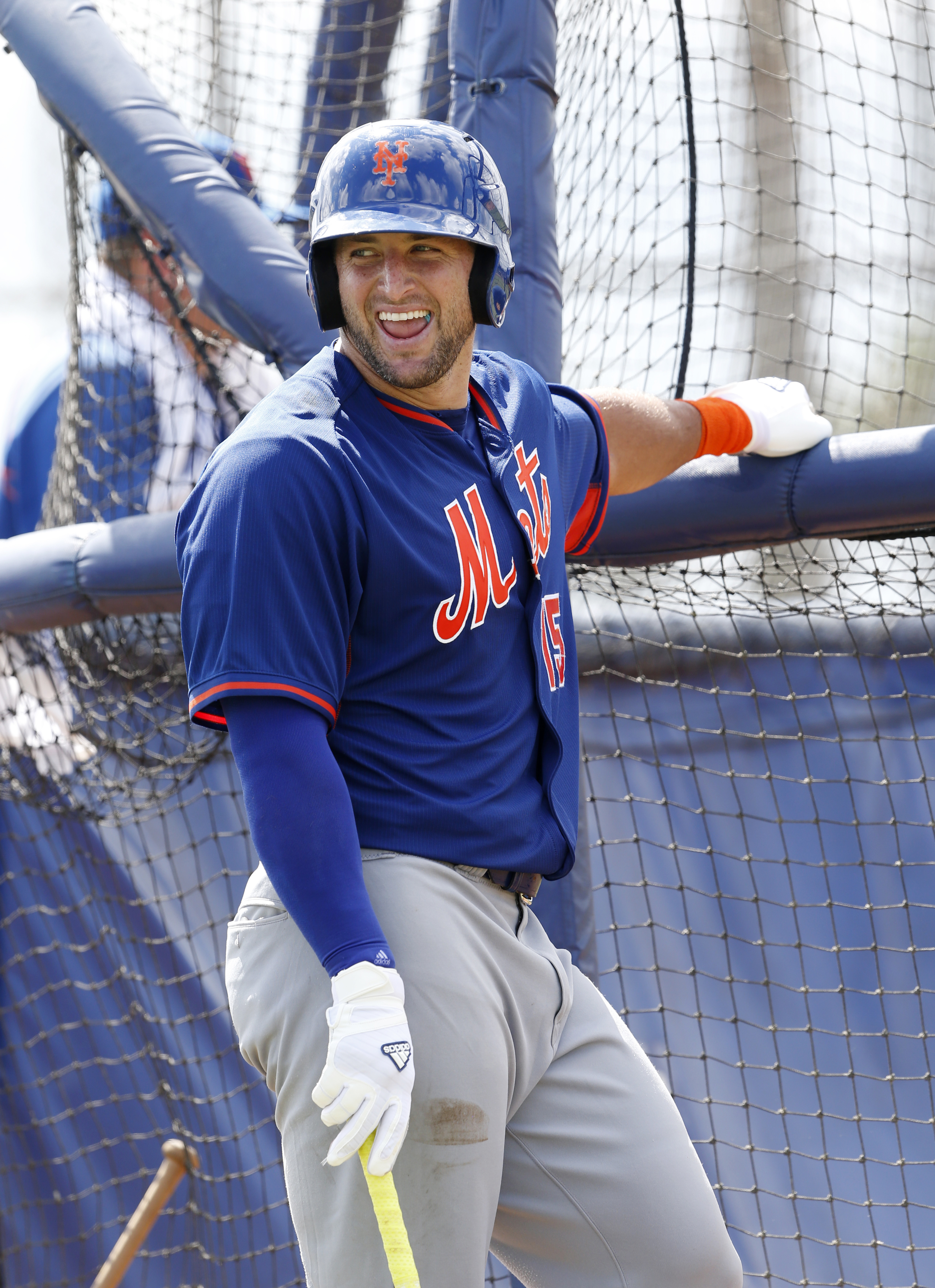 Tim Tebow laughs as he waits his turn for batting practice, Tuesday, Sept. 20, 2016, in Port St. Lucie, Fla. The 2007 Heisman Trophy winner and former NFL quarterback practiced at the New York Mets' complex during his second workout as part of their instr