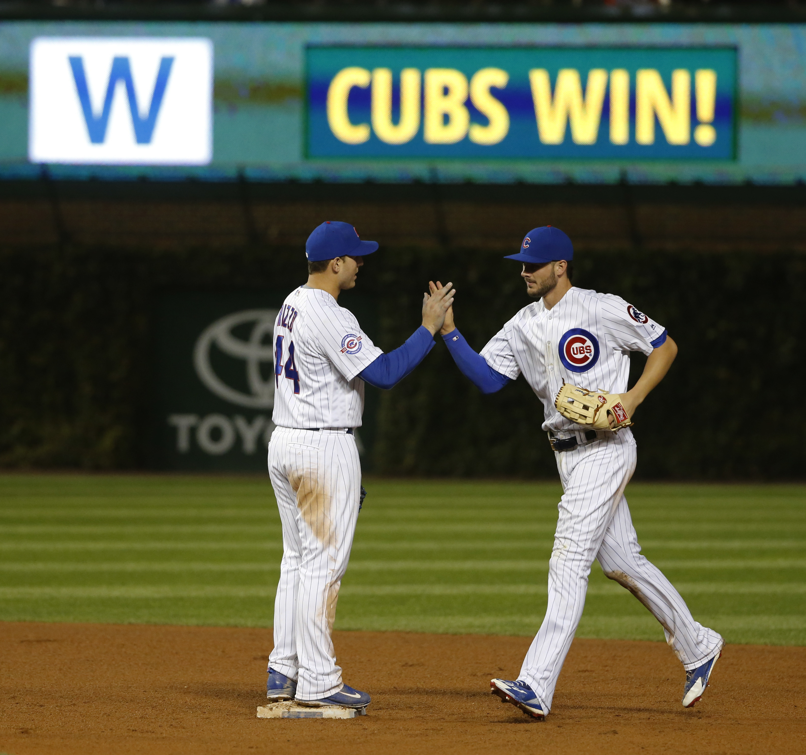 Chicago Cubs first baseman Anthony Rizzo, left, and Kris Bryant celebrate the Cubs' 6-1 win over the Cincinnati Reds after a baseball game Tuesday, Sept. 20, 2016, in Chicago. (AP Photo/Charles Rex Arbogast)