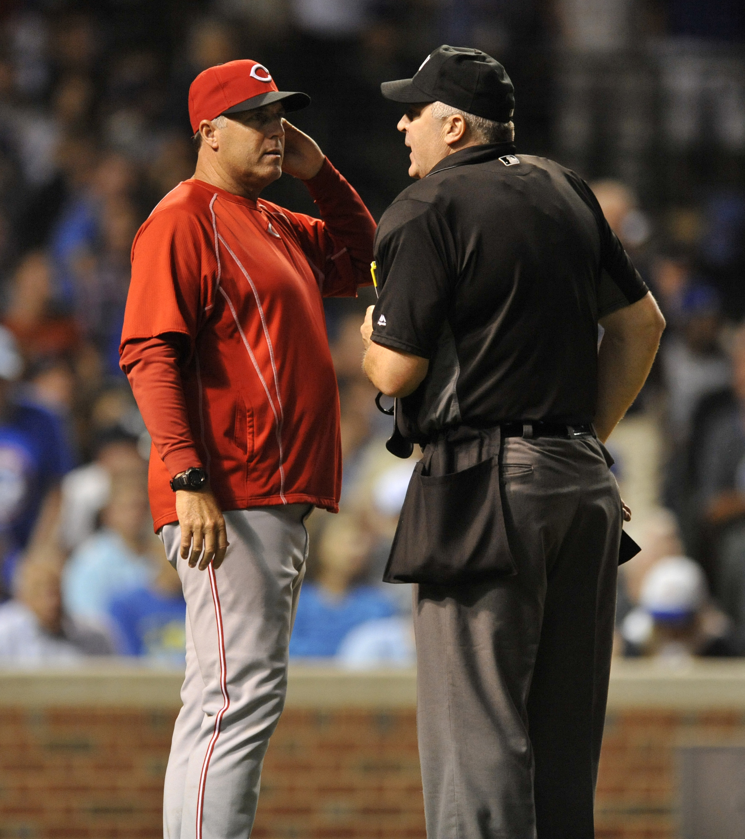 Cincinnati Reds manager Bryan Price left, talks with home plate umpire Bill Welke right, after a balk was called on pitcher Michael Lorenzen during the fifth inning of a baseball game against the Chicago Cubs Wednesday, Sept. 21, 2016, in Chicago. (AP Pho