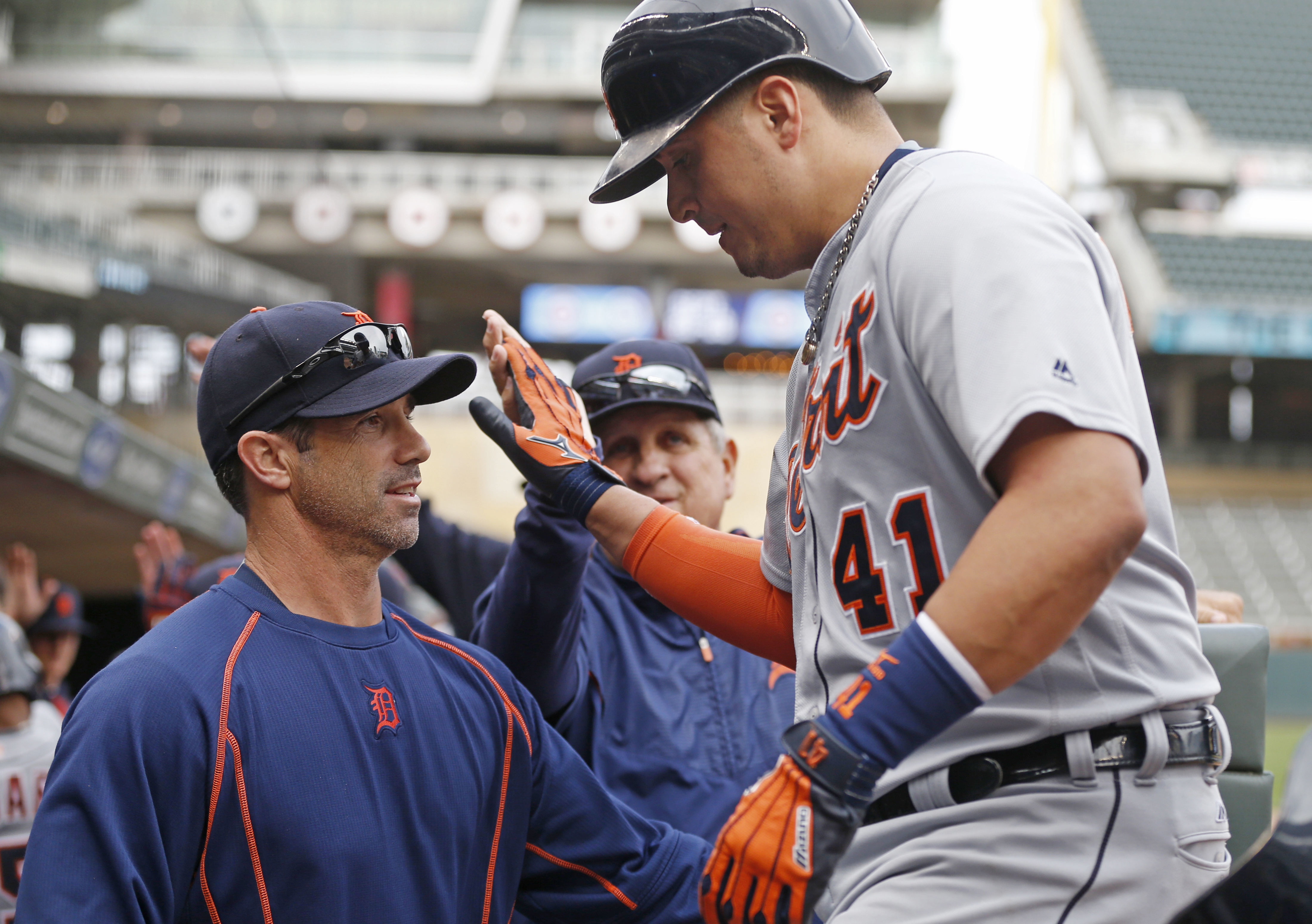 Detroit Tigers pinch hitter Victor Martinez is greete at the dugout after hitting a three-run home run off Minnesota Twins pitcher Michael Tonkin during the ninth inning in the first game of a baseball doubleheader Thursday, Sept. 22, 2016, in Minneapolis
