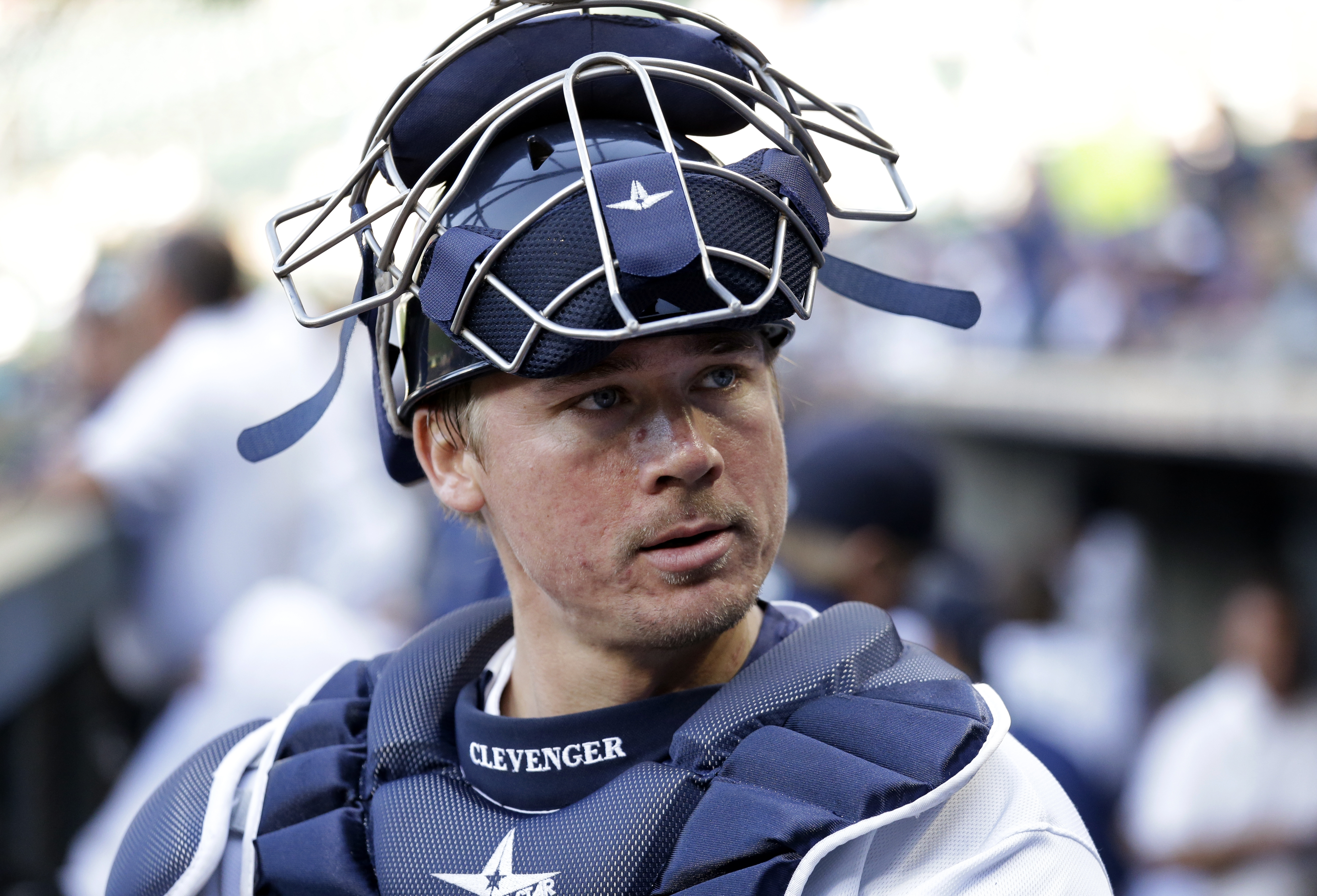 Seattle Mariners catcher Steve Clevenger looks out of the dugout before a baseball game against the Pittsburgh Pirates Wednesday, June 29, 2016, in Seattle. (AP Photo/Elaine Thompson)