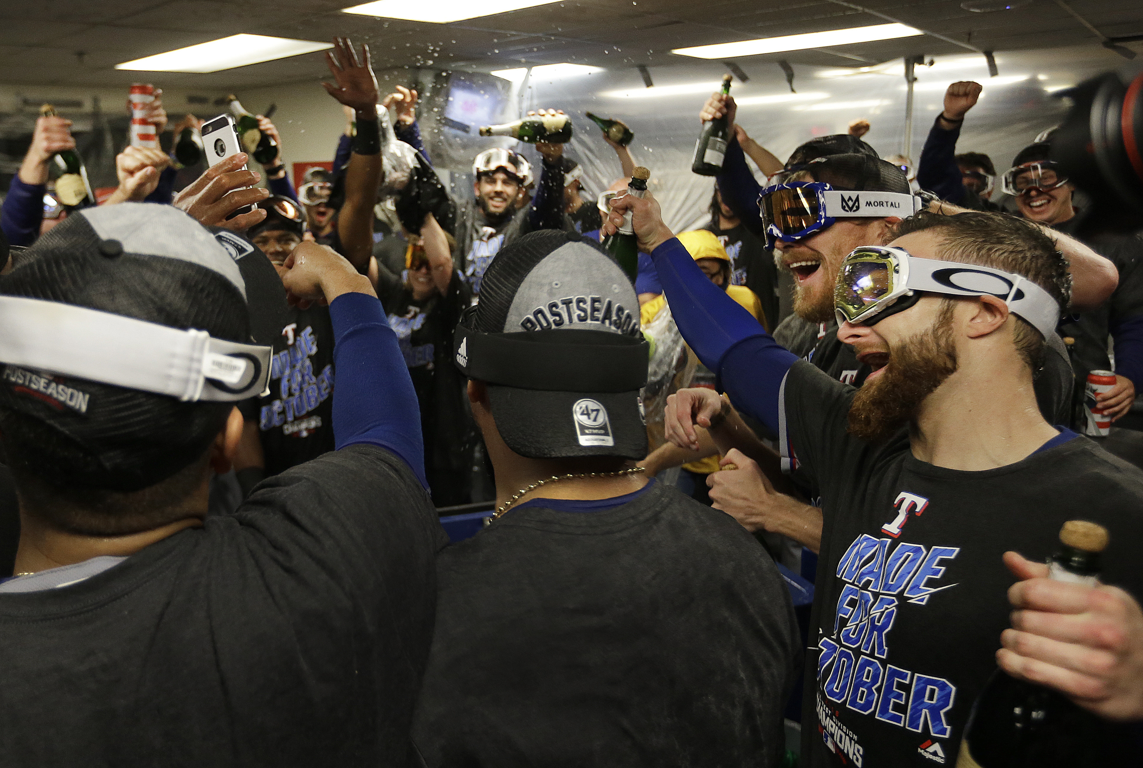 Texas Rangers celebrate after clinching the American League Western Division after a baseball game against the Oakland Athletics Friday, Sept. 23, 2016, in Oakland, Calif. (AP Photo/Ben Margot)