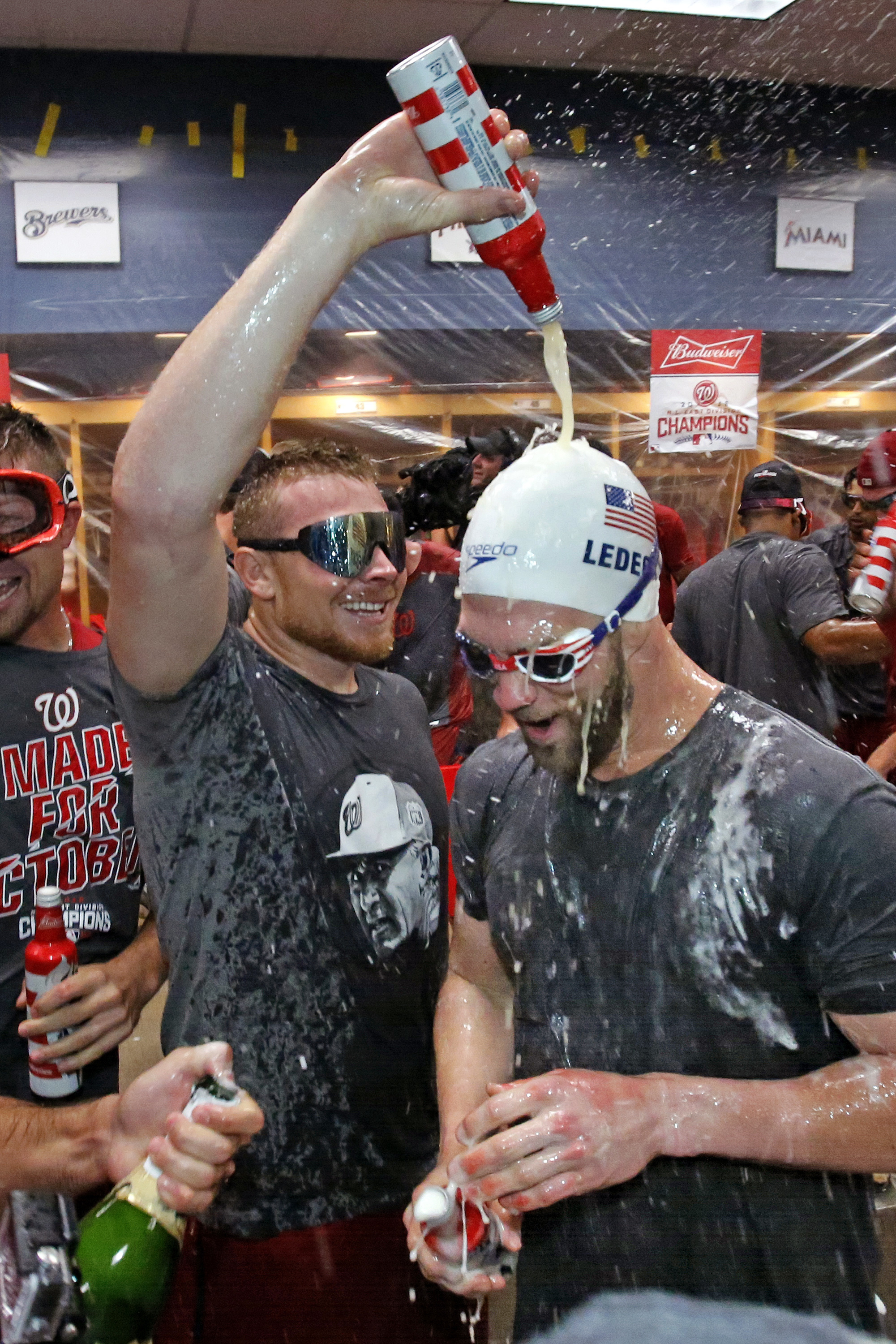 Washington Nationals' Bryce Harper, right, and Mark Melancon, left, celebrate after clinching the National League East following a 6-1 win over the Pittsburgh Pirates in a baseball game in Pittsburgh, Saturday, Sept. 24, 2016. (AP Photo/Gene J. Puskar)