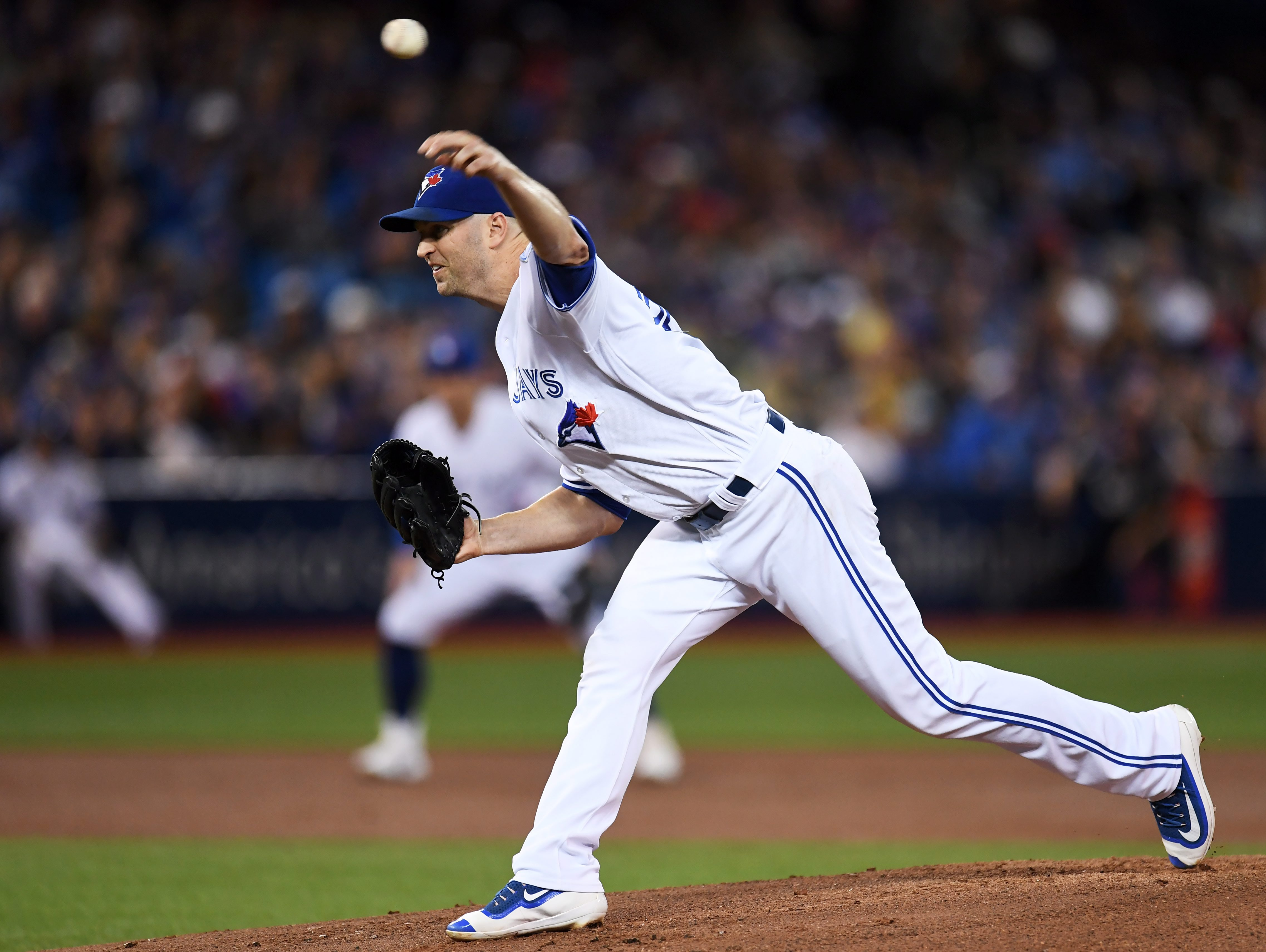 Toronto Blue Jays' J.A. Happ works against the New York Yankees during the first inning of a baseball game Monday, Sept. 26, 2016, in Toronto. (Frank Gunn/The Canadian Press via AP)