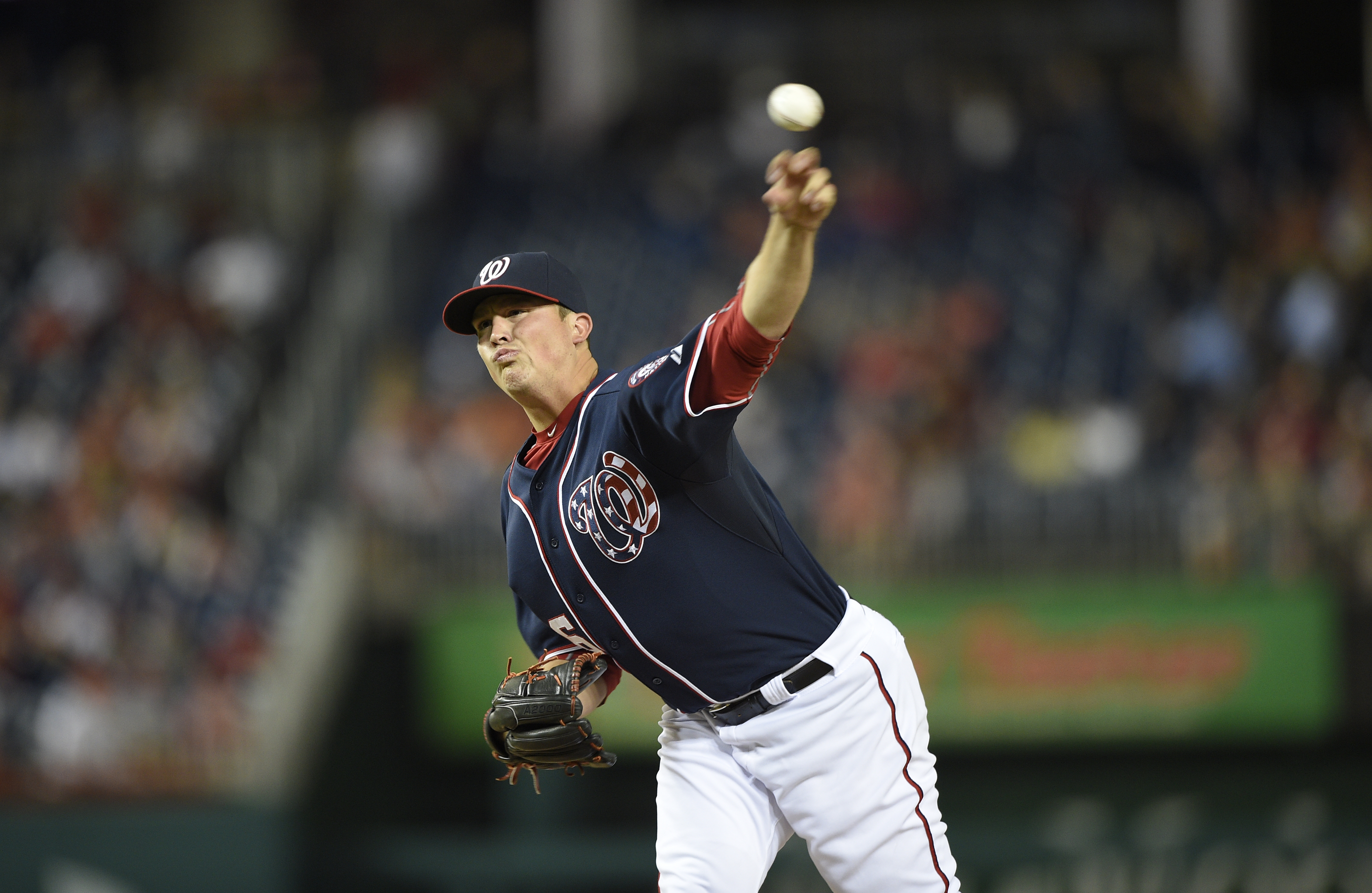 In this photo taken Sept. 25, 2015, Washington Nationals relief pitcher Sammy Solis (36) pitches against the Philadelphia Phillies during a baseball game in Washington. When the Washington Nationals face the Los Angeles Dodgers in the NL Division Series,