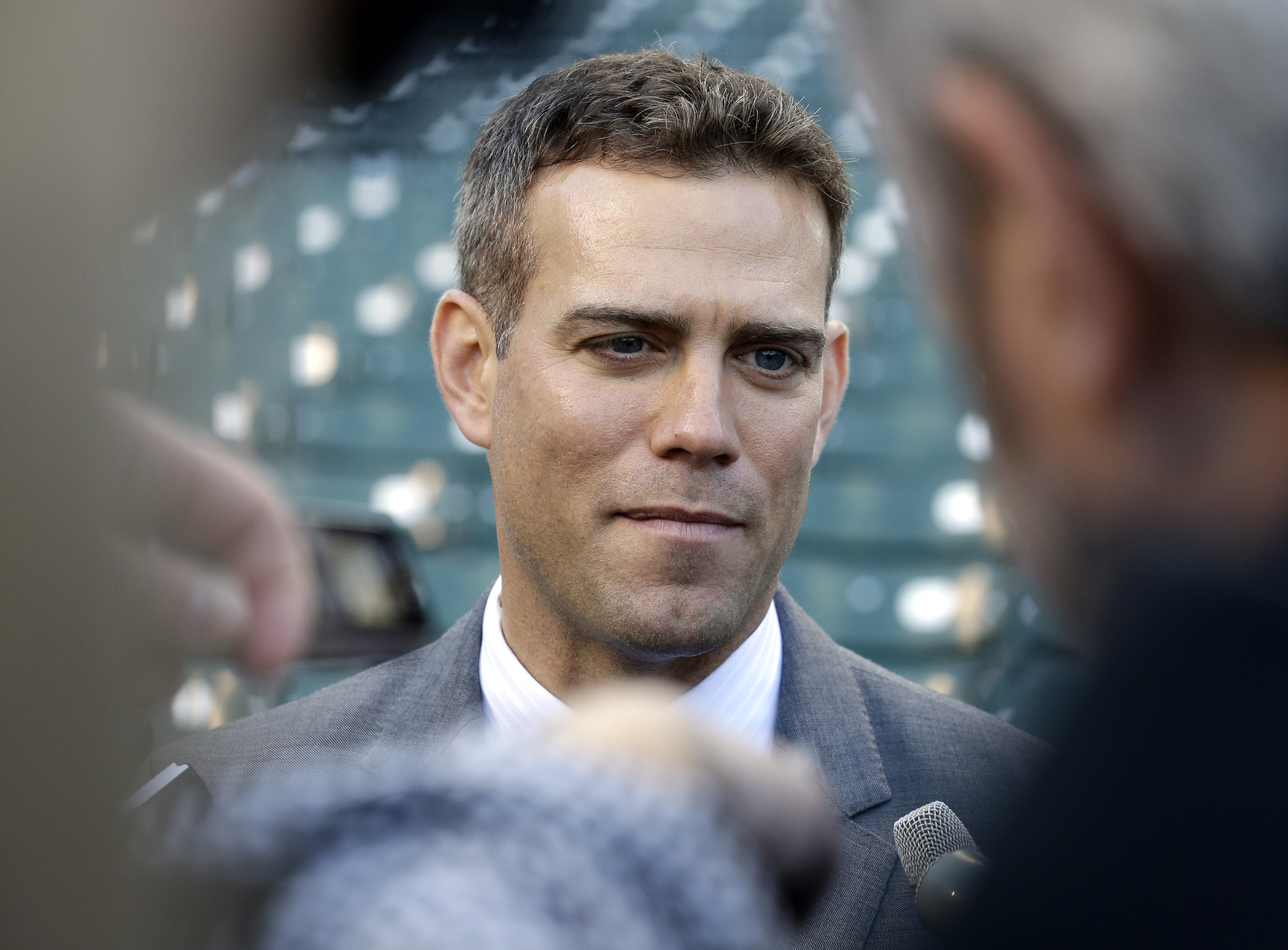 FILE - In this Monday, April 11, 2016 file photo, Chicago Cubs president Theo Epstein talks to media at Wrigley Field before the start of an opening day baseball game between the Cincinnati Reds and the Chicago Cubs in Chicago. The Chicago Cubs have agree
