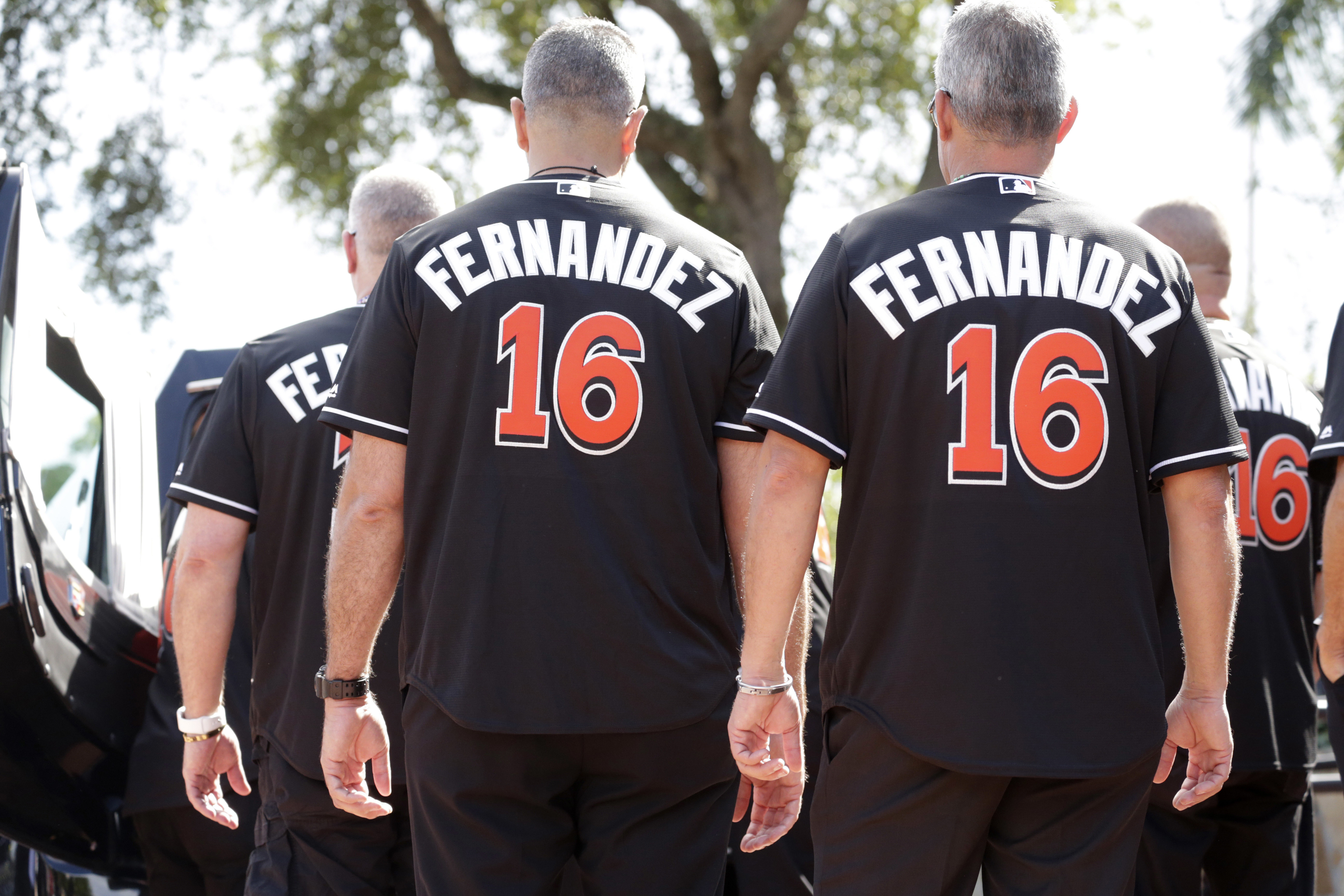 Pallbearers wearing the number 16 jersey, prepare to carry the coffin carrying Miami Marlins pitcher Jose Fernandez into a memorial service at St. Brendan's Catholic Church, Wednesday, Sept. 28, 2016, in Miami. Fernandez, was killed in a weekend boat cras