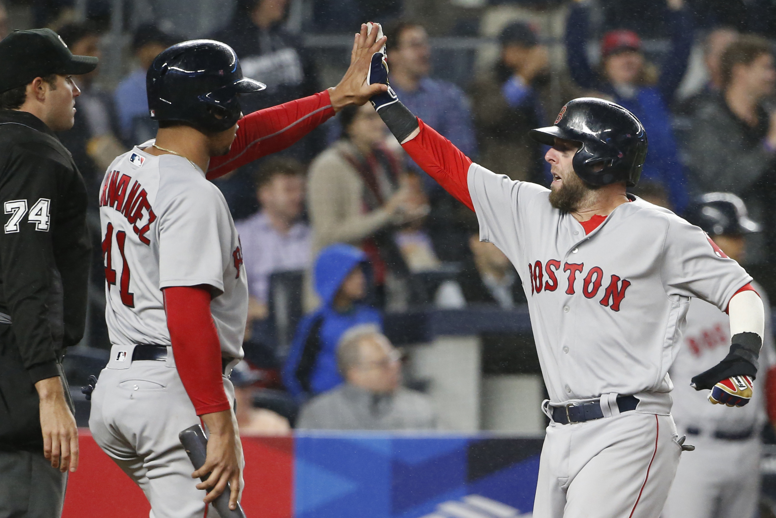 Boston Red Sox Marco Hernandez (41) greets Boston Red Sox Dustin Pedroia (15) after Pedroia scored on an eighth-inning, two-run double by Mookie Betts in a baseball game against the New York Yankees in New York, Wednesday, Sept. 28, 2016. (AP Photo/Kathy