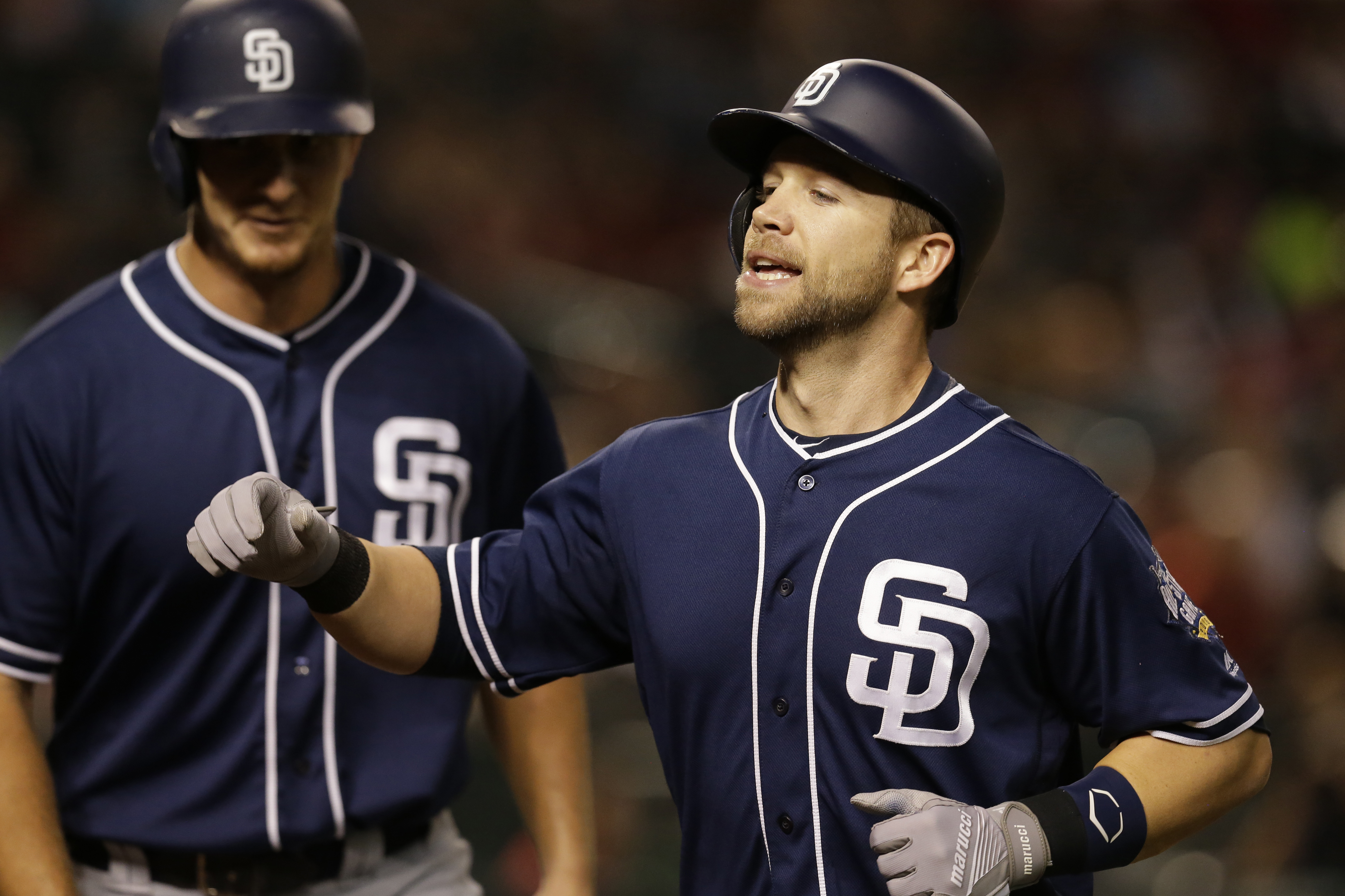 San Diego Padres Ryan Schimpf, right, celebrates after hitting a two-run home run against the Arizona Diamondbacks  in the fourth inning during a baseball game, Friday, Sept. 30, 2016, in Phoenix. (AP Photo/Rick Scuteri)