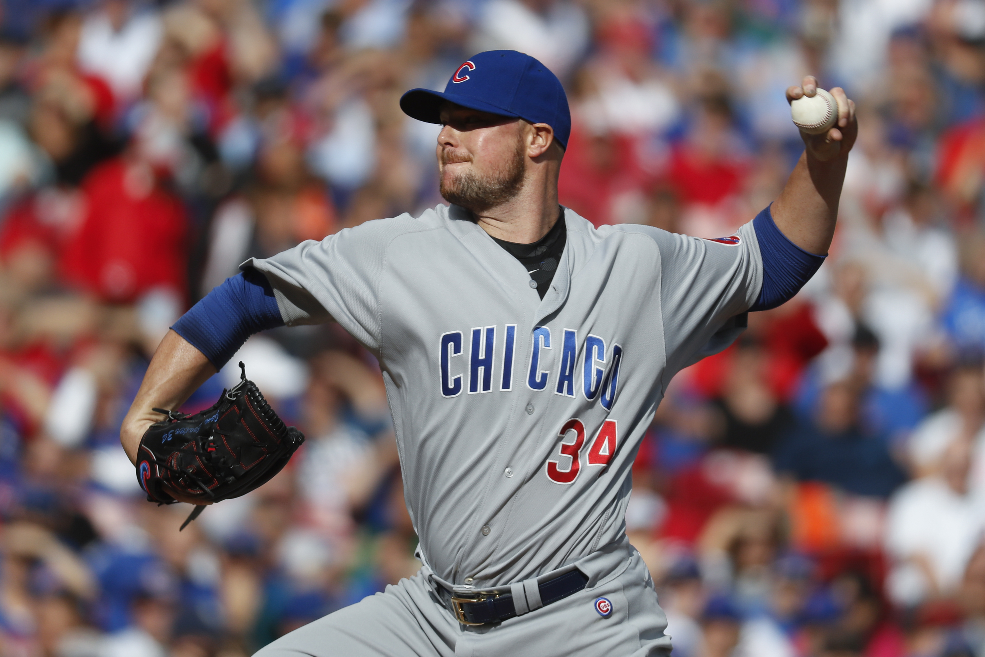 Chicago Cubs starting pitcher Jon Lester throws in the first inning of a baseball game against the Cincinnati Reds, Saturday, Oct. 1, 2016, in Cincinnati. (AP Photo/John Minchillo)