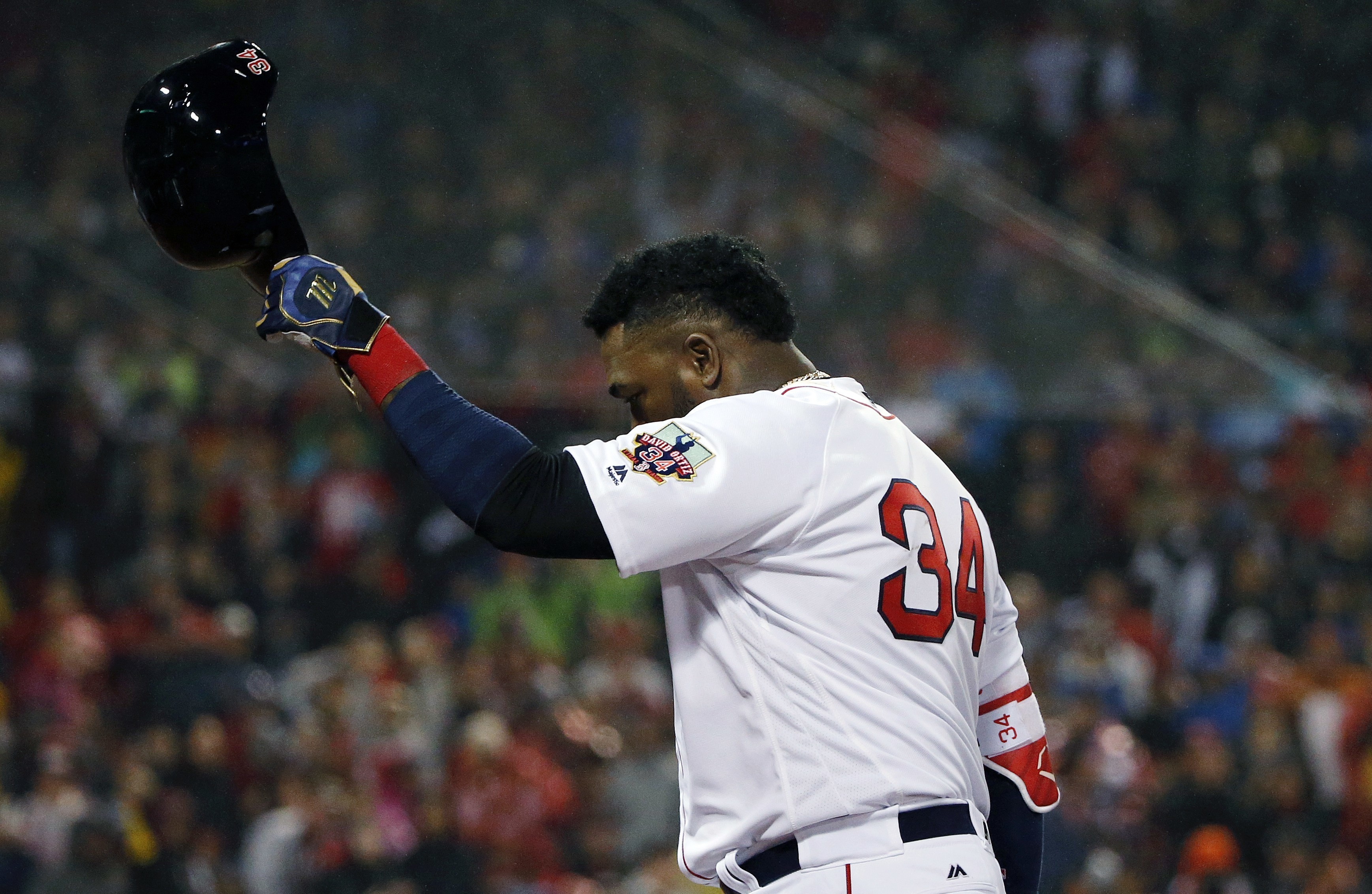 Boston Red Sox's David Ortiz tips his helmet as he walks off the field after Travis Shaw was sent in to pinch run on Oritz's single during the fifth inning of a baseball game against the Toronto Blue Jays in Boston, Saturday, Oct. 1, 2016. (AP Photo/Micha