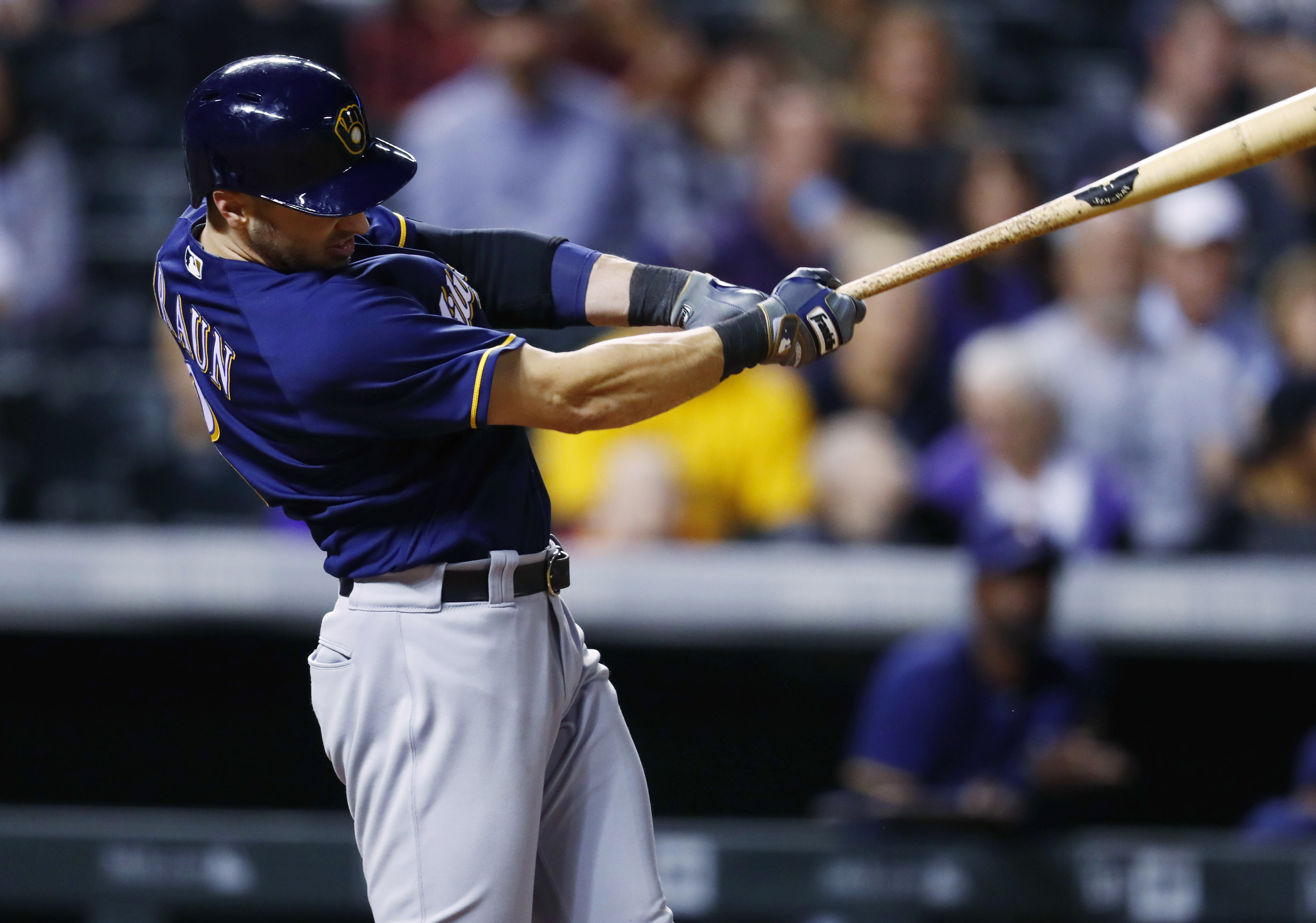 Milwaukee Brewers' Ryan Braun follows through on an RBI double off Colorado Rockies relief pitcher Jordan Lyles during the eighth inning of a baseball game Saturday, Oct. 1, 2016, in Denver. Milwaukee won 4-3 in 10 innings. (AP Photo/David Zalubowski)