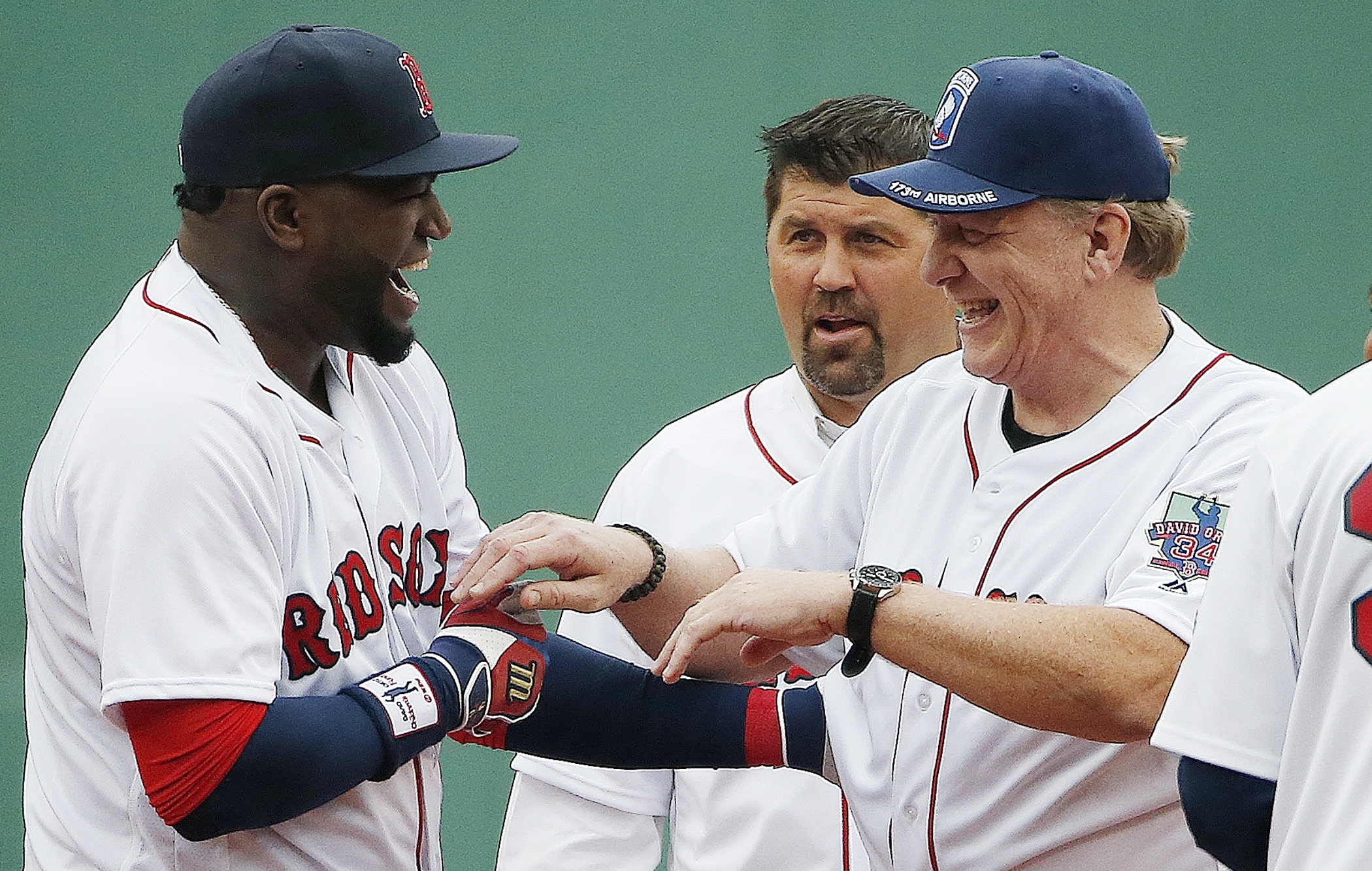 Boston Red Sox's David Ortiz, left, jokes with former teammates Curt Schilling, right, and Jason Varitek during a ceremony before a baseball game against the Toronto Blue Jays in Boston, Sunday, Oct. 2, 2016. (AP Photo/Michael Dwyer)