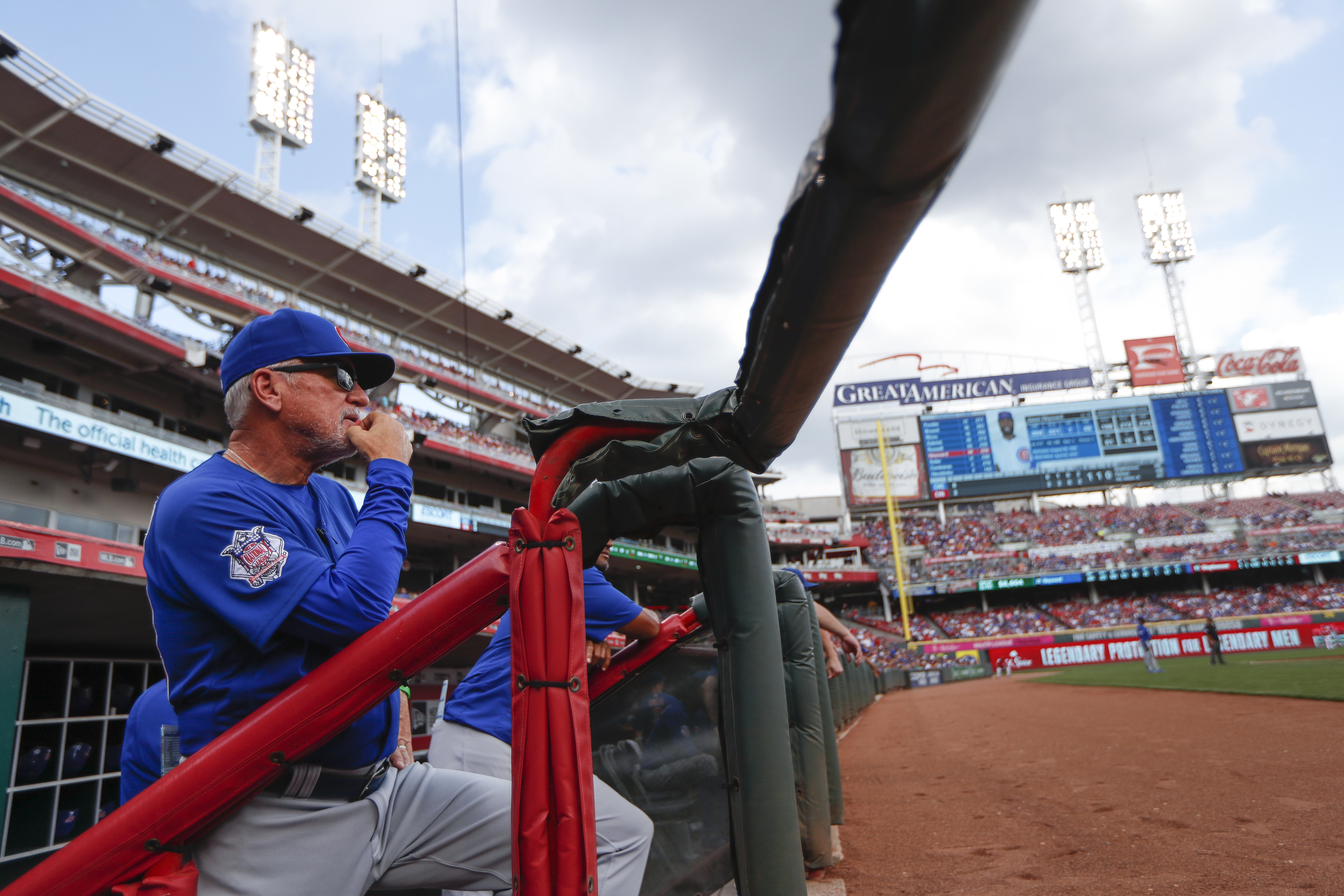 Chicago Cubs manager Joe Maddon watches from the dugout in the second inning of a baseball game against the Cincinnati Reds, Sunday, Oct. 2, 2016, in Cincinnati. (AP Photo/John Minchillo)