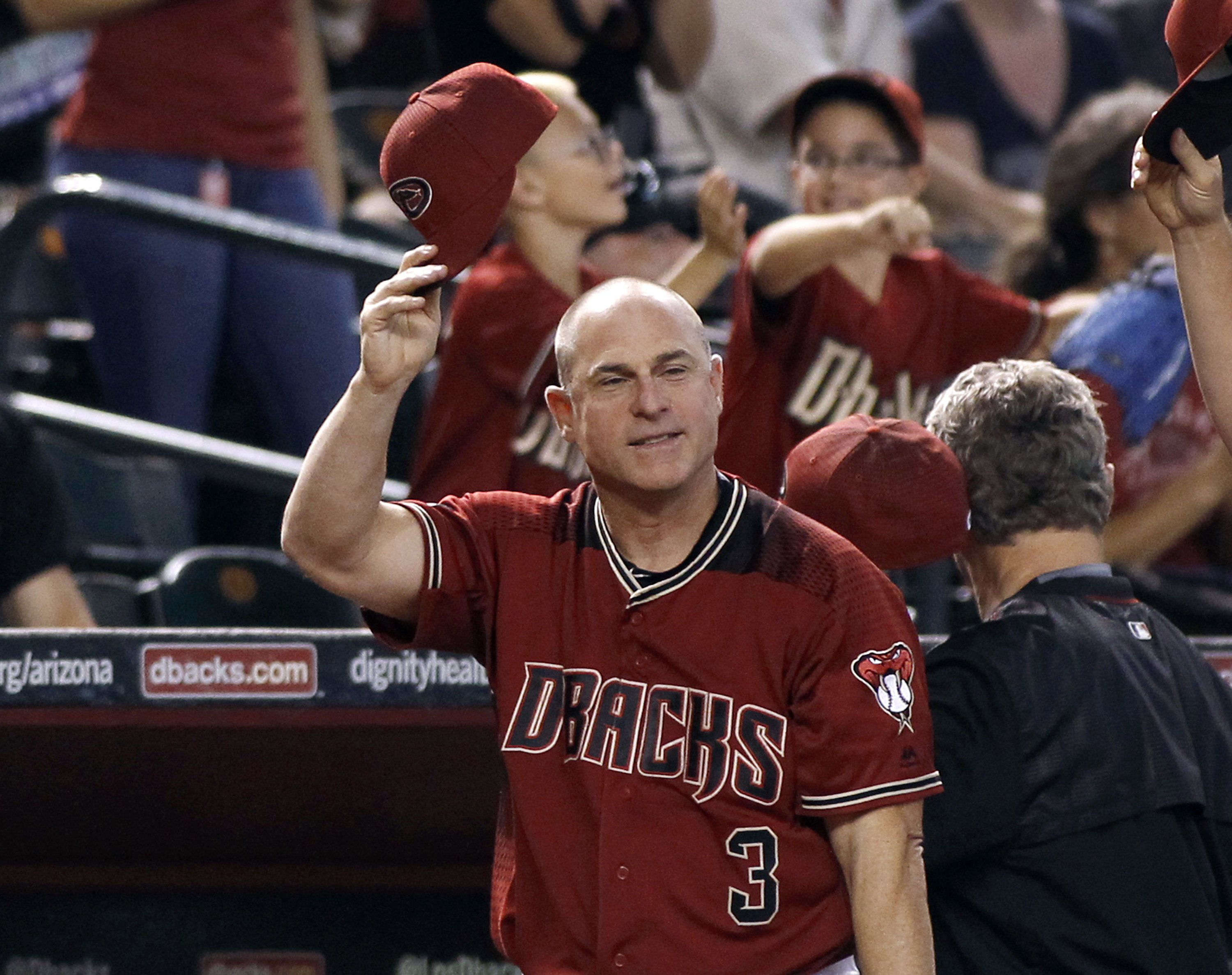 Arizona Diamondbacks manager Chip Hale salutes the fans for their support during the season during the middle of the sixth inning of a baseball game against the San Diego Padres, Sunday, Oct. 2, 2016, in Phoenix. (AP Photo/Ralph Freso)