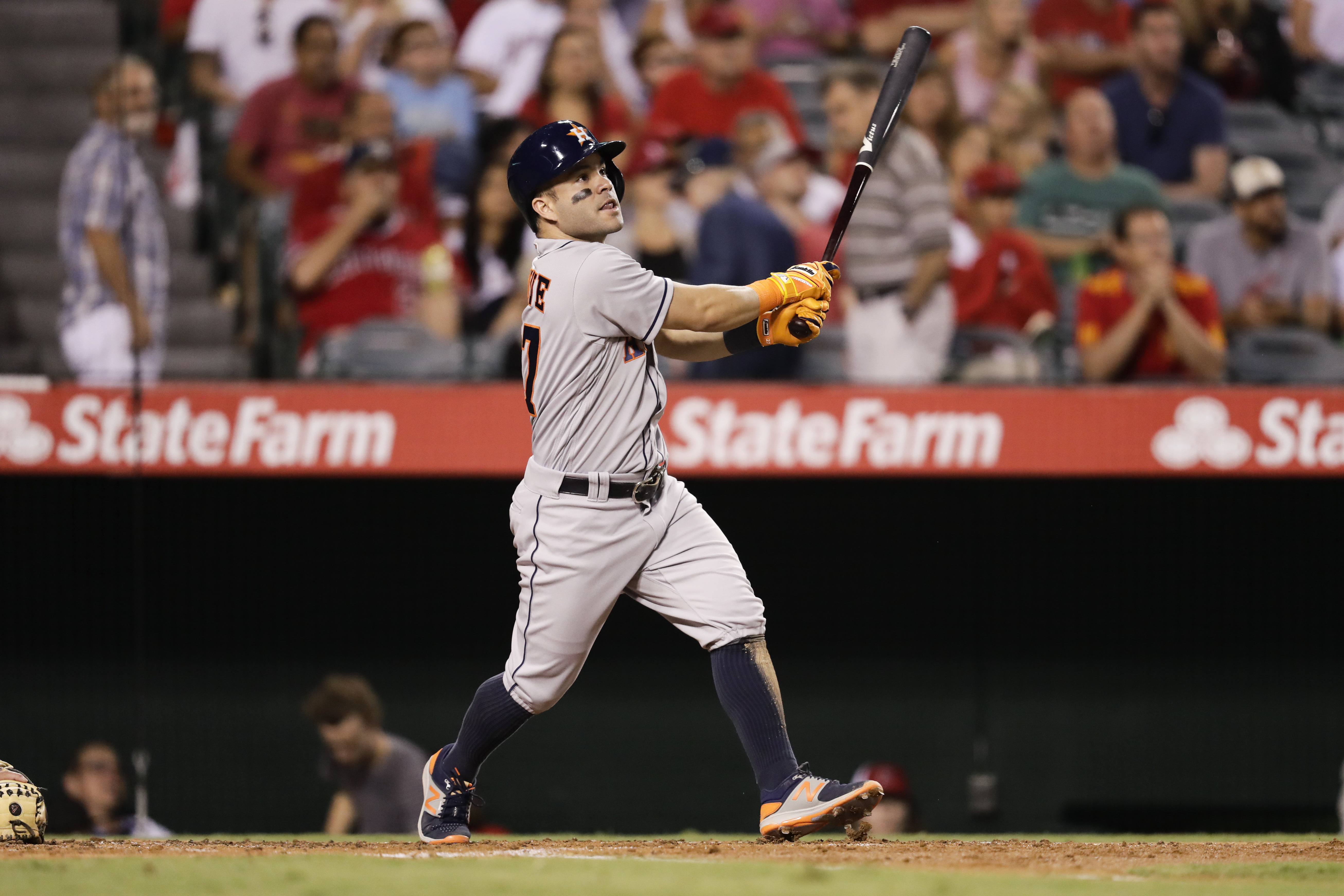 FILE - In this Oct. 1, 2016, file photo, Houston Astros' Jose Altuve watches his fly ball during the third inning of a baseball game against the Los Angeles Angels, Saturday, Oct. 1, 2016, in Anaheim, Calif. Altuve hit .338 for the season to win his secon
