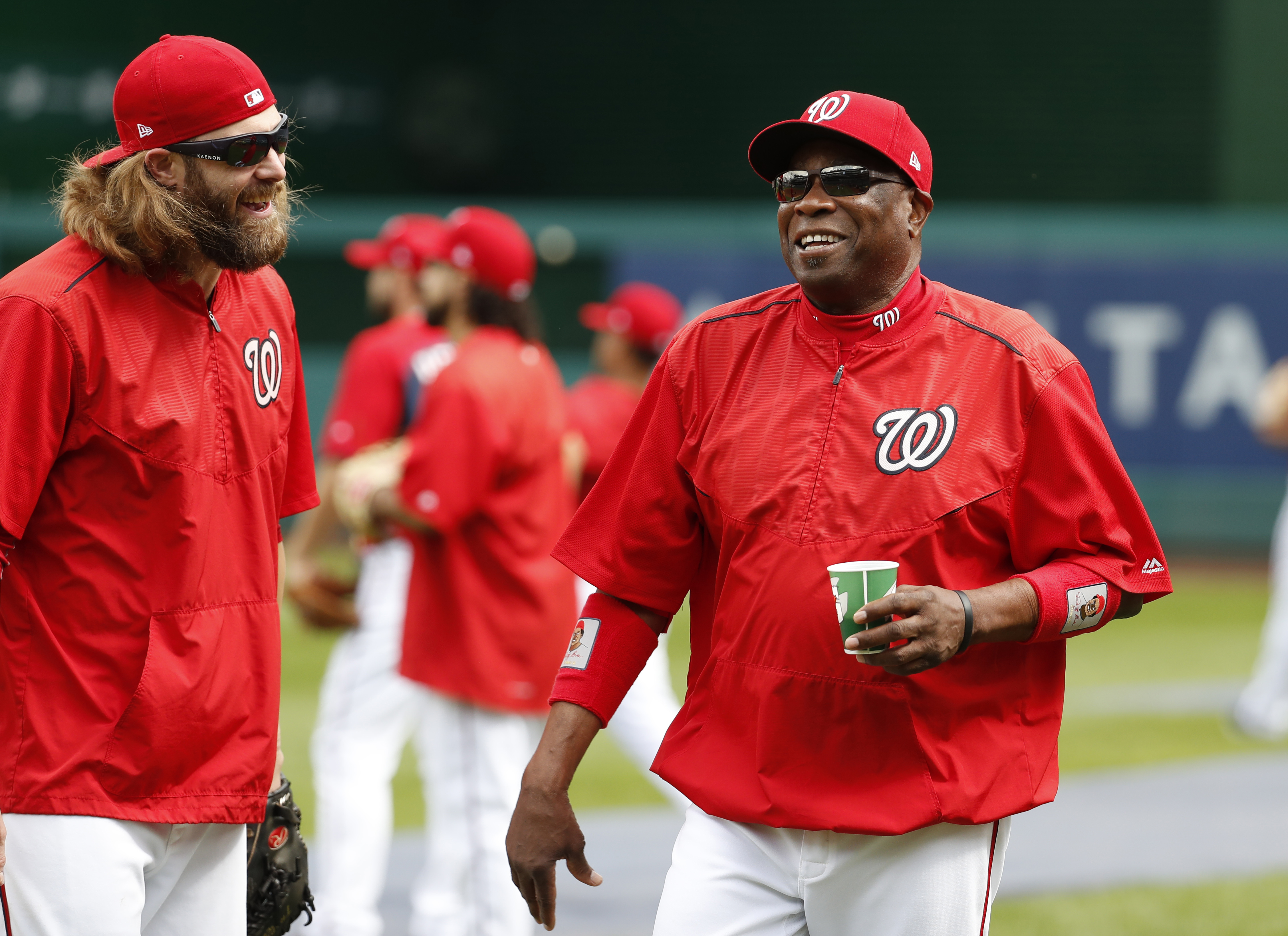 Washington Nationals left fielder Jayson Werth, left, and manager Dusty Baker share a laugh during baseball batting practice at Nationals Park, Tuesday, Oct. 4, 2016, in Washington. The Nationals host the Los Angeles Dodgers in Game 1 of the National Leag