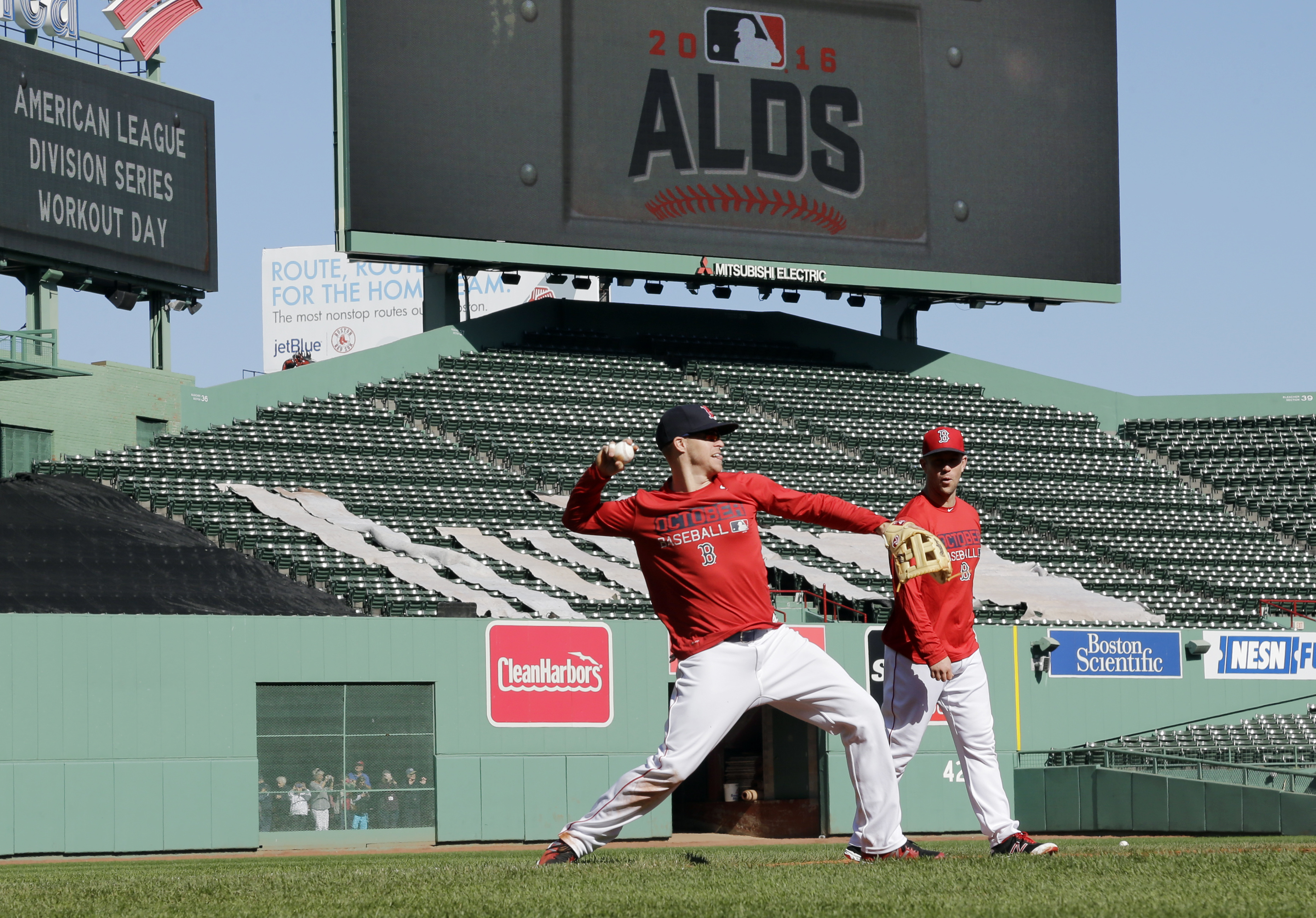 Boston Red Sox's Brock Holt, left, throws as Aaron Hill watches during baseball team workout at Fenway Park, Tuesday, Oct. 4, 2016, in Boston, as they prepare for Game 1 of the  American League Division Series scheduled for Thursday in Cleveland. (AP Phot