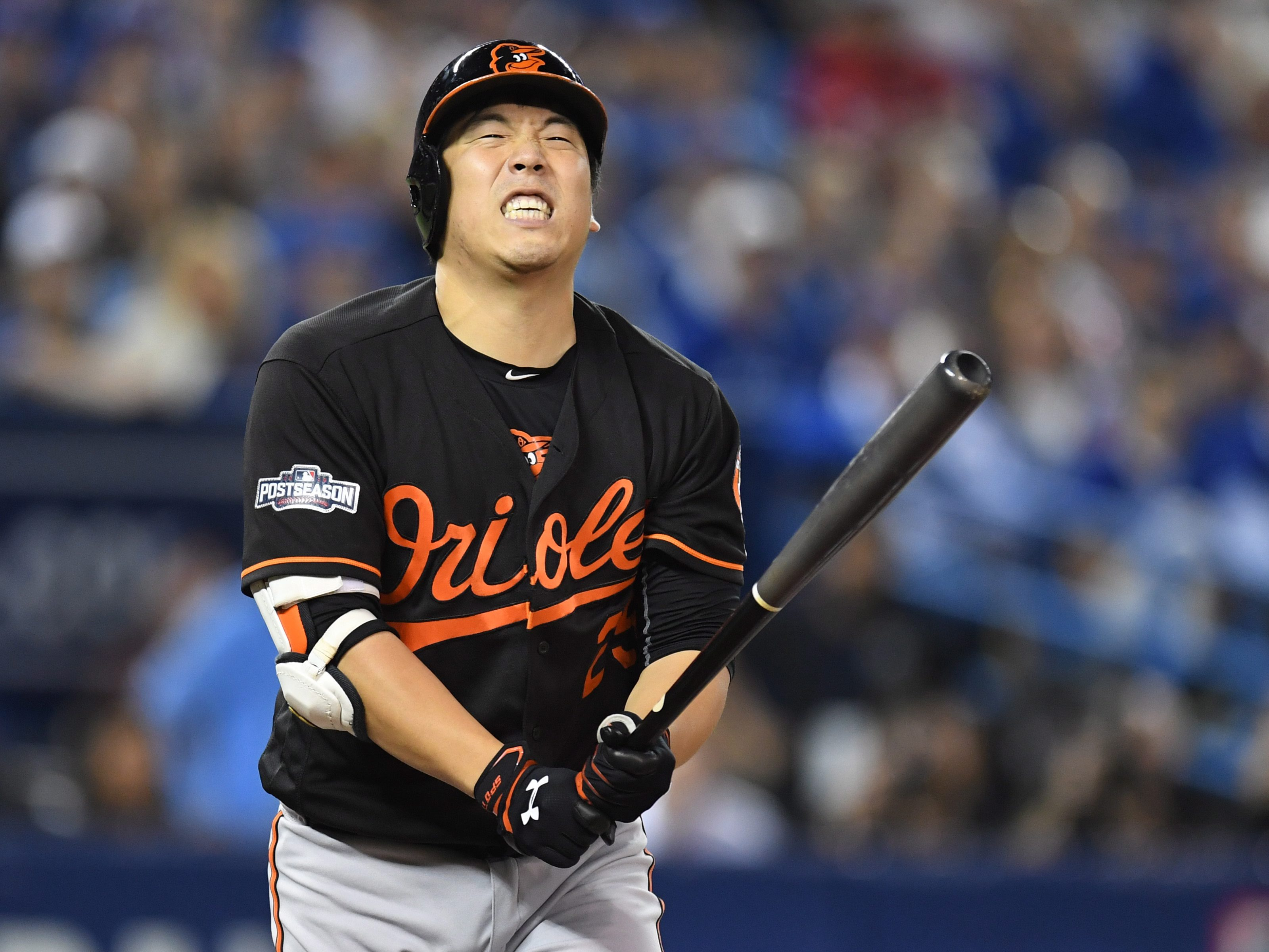 Baltimore Orioles' Hyun Soo Kim reacts to a strike against the Toronto Blue Jays during fourth inning of an American League wild-card baseball game in Toronto, Tuesday, Oct. 4, 2016. (Frank Gunn/The Canadian Press via AP)