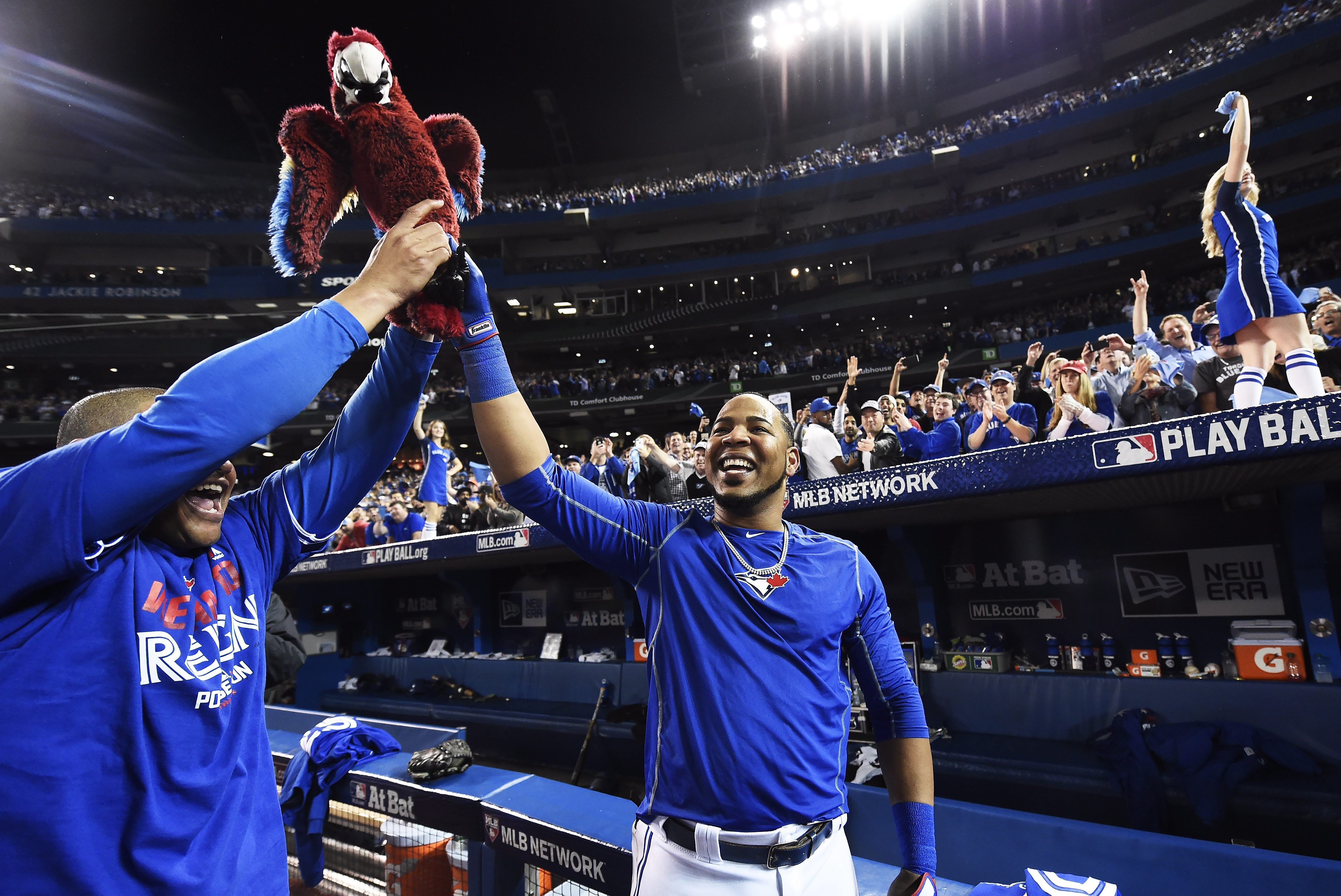 Toronto Blue Jays' Edwin Encarnacion celebrates his game winning walk-off three-run home run against the Baltimore Orioles with teammate Ezequiel Carrera during the 11th inning of an American League wild-card baseball game in Toronto, Tuesday, Oct. 4, 201