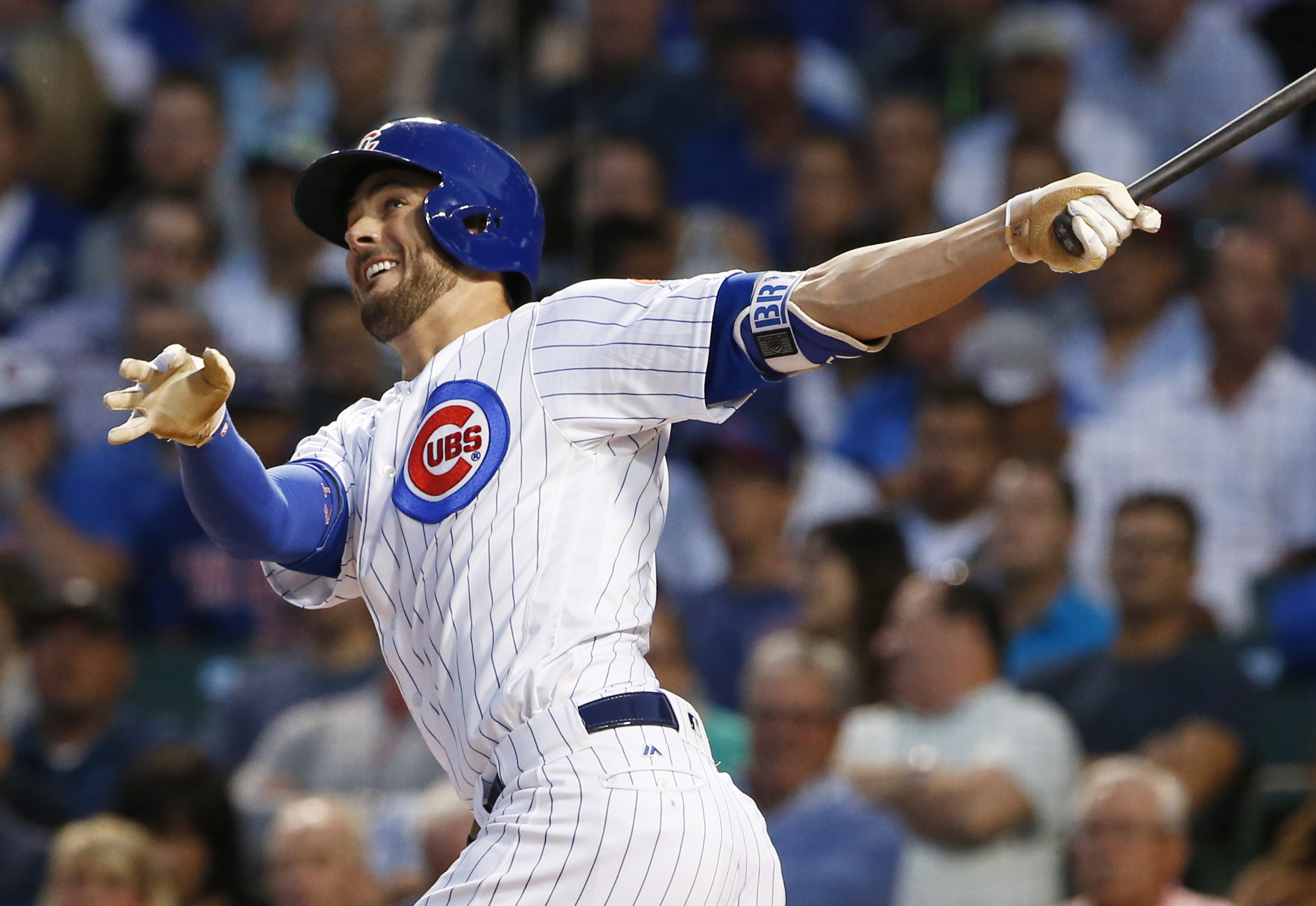 FILE - In this Aug. 31, 2016, file photo, Chicago Cubs' Kris Bryant follows through on a solo home run during the first inning of a baseball game against the Pittsburgh Pirates, in Chicago. Bryant, Bryce Harper and Big Papi are just a few of the big-name