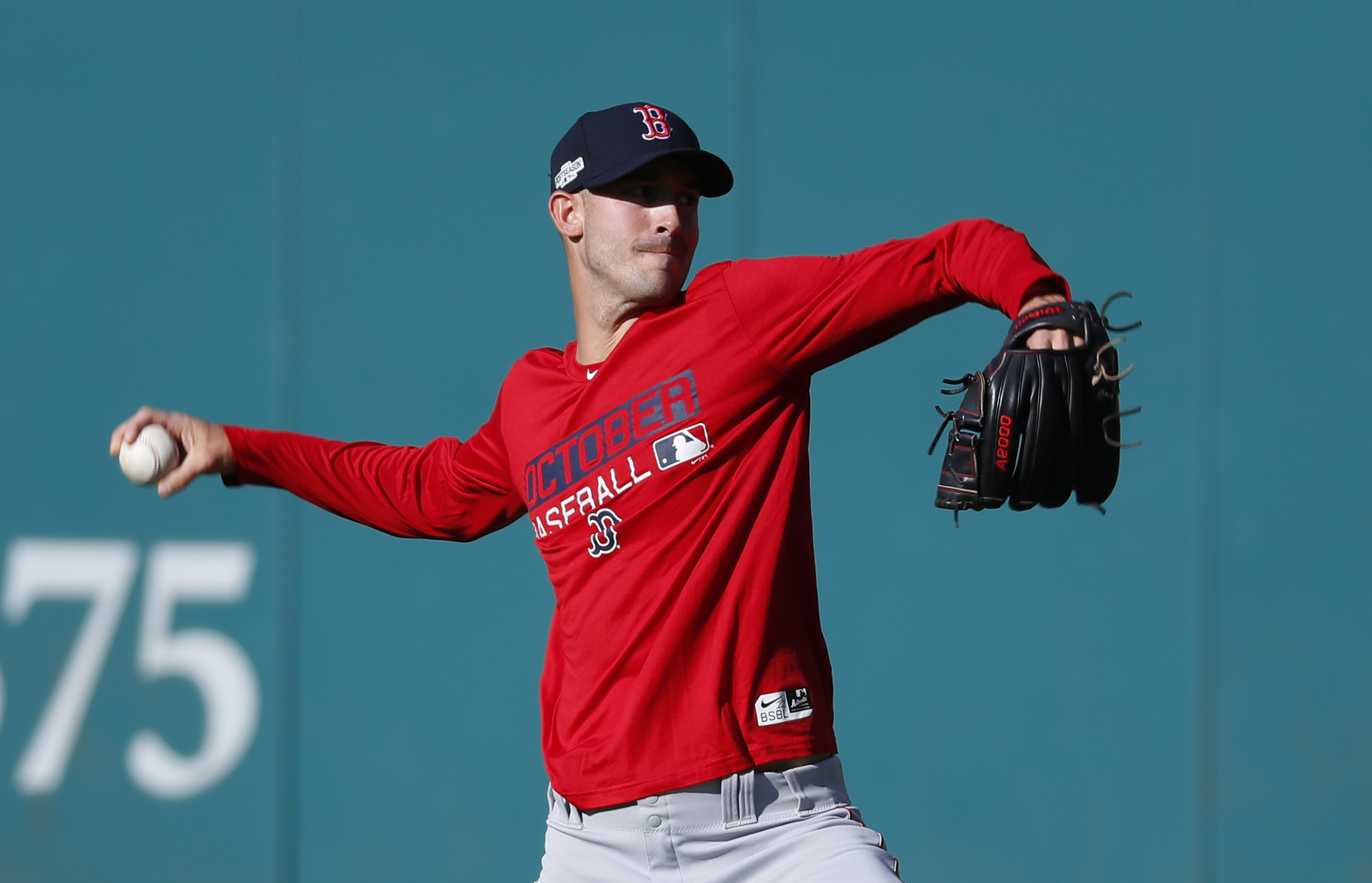 Boston Red Sox pitcher Rick Porcello throws during baseball practice in Cleveland, Wednesday, Oct. 5, 2016. The Red Sox take on the Cleveland Indians in Game 1 of baseball's American League Division Series Thursday. (AP Photo/Paul Sancya)