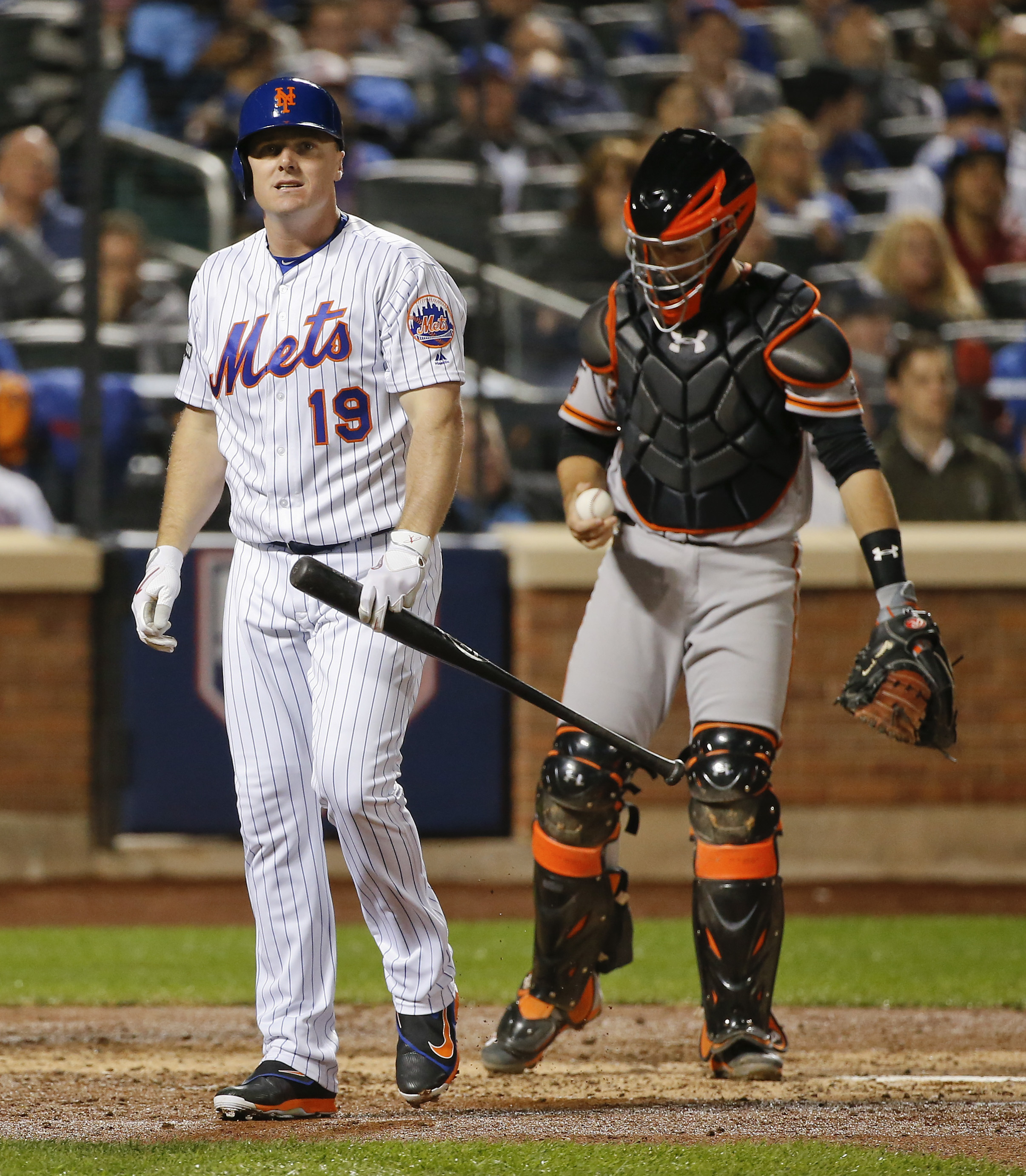New York Mets' Jay Bruce (19) reacts after striking out against the San Francisco Giants during the fifth inning of the National League wild-card baseball game against the San Francisco Giants, Wednesday, Oct. 5, 2016, in New York. (AP Photo/Kathy Willens