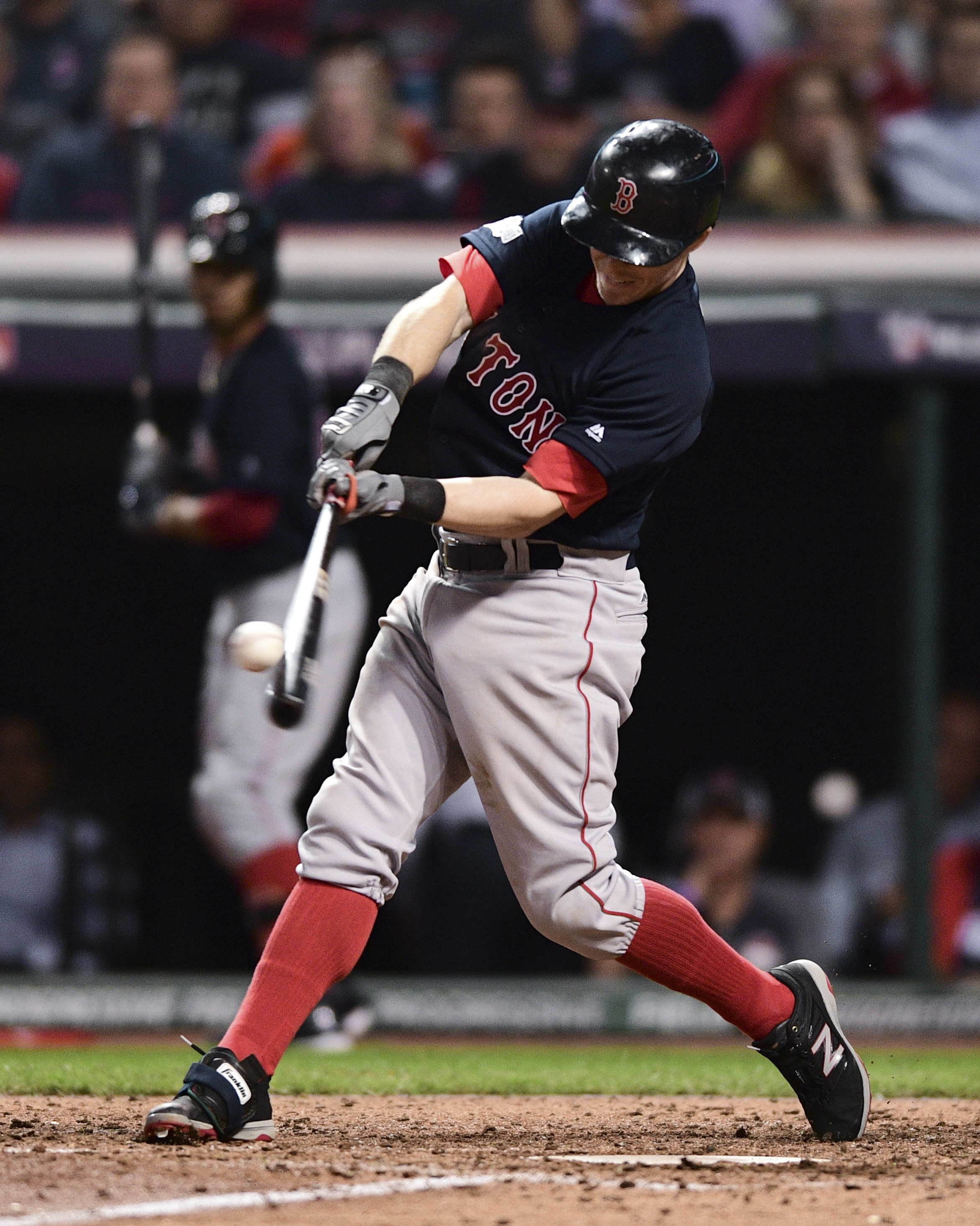 Boston Red Sox's Brock Holt hits a solo home run against the Cleveland Indians in the eighth inning during Game 1 of baseball's American League Division Series, Thursday, Oct. 6, 2016, in Cleveland. (AP Photo/David Dermer)
