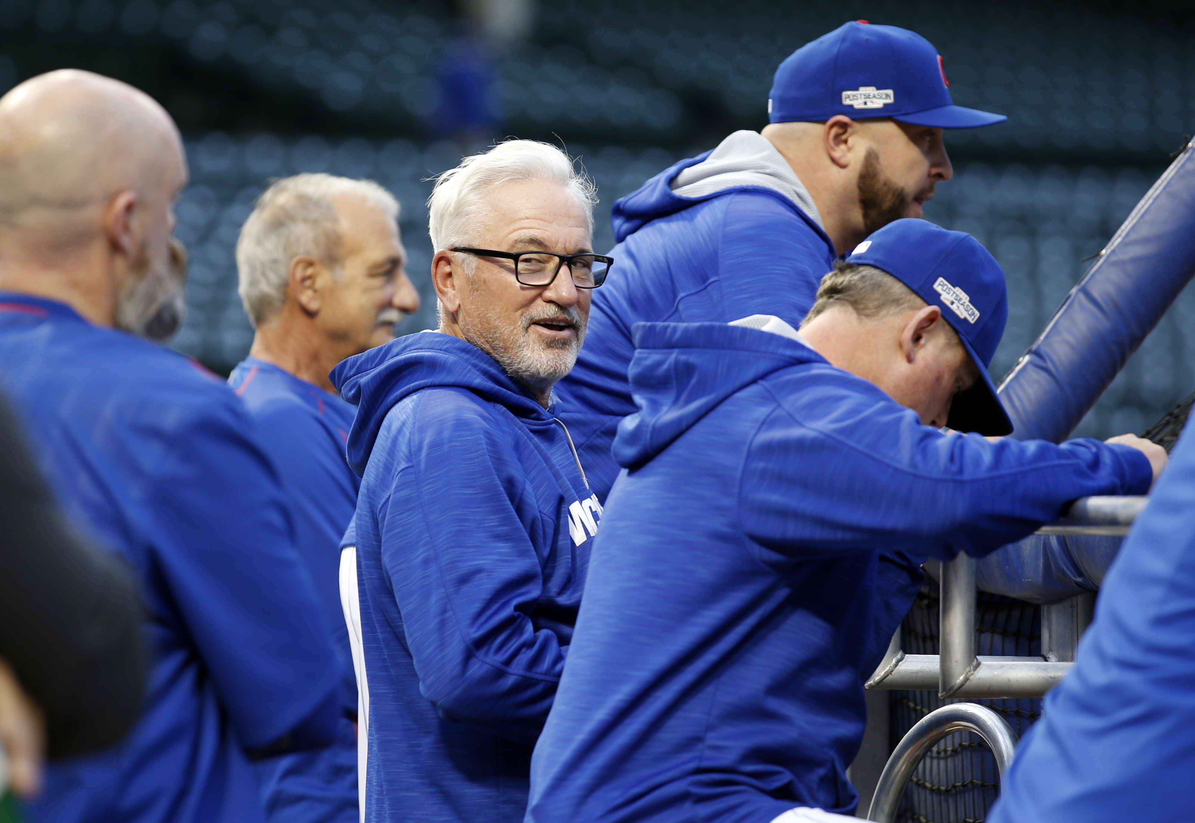 Chicago Cubs manager Joe Maddon watches as players warm up during batting practice before Game 1 of baseball's National League Division Series against the San Francisco Giants, Friday, Oct. 7, 2016, in Chicago. (AP Photo/Nam Y. Huh)